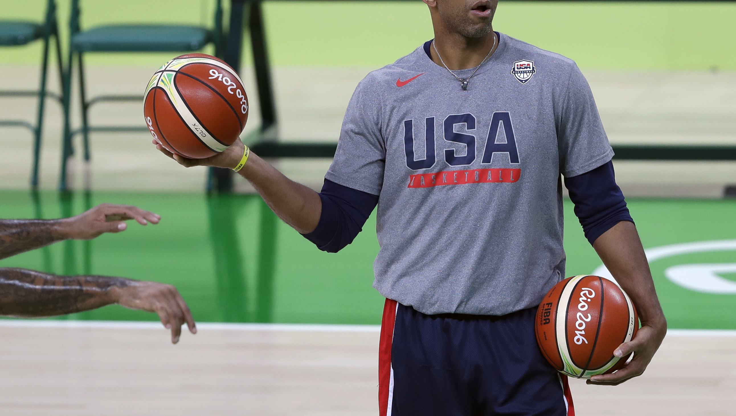 FILE - In this Thursday, Aug. 4, 2016 file photo, United States assistant coach Monty Williams feeds balls to Carmelo Anthony, out of frame left, during a basketball practice session for the 2016 Summer Olympics in Rio de Janeiro, Brazil. Without his wife