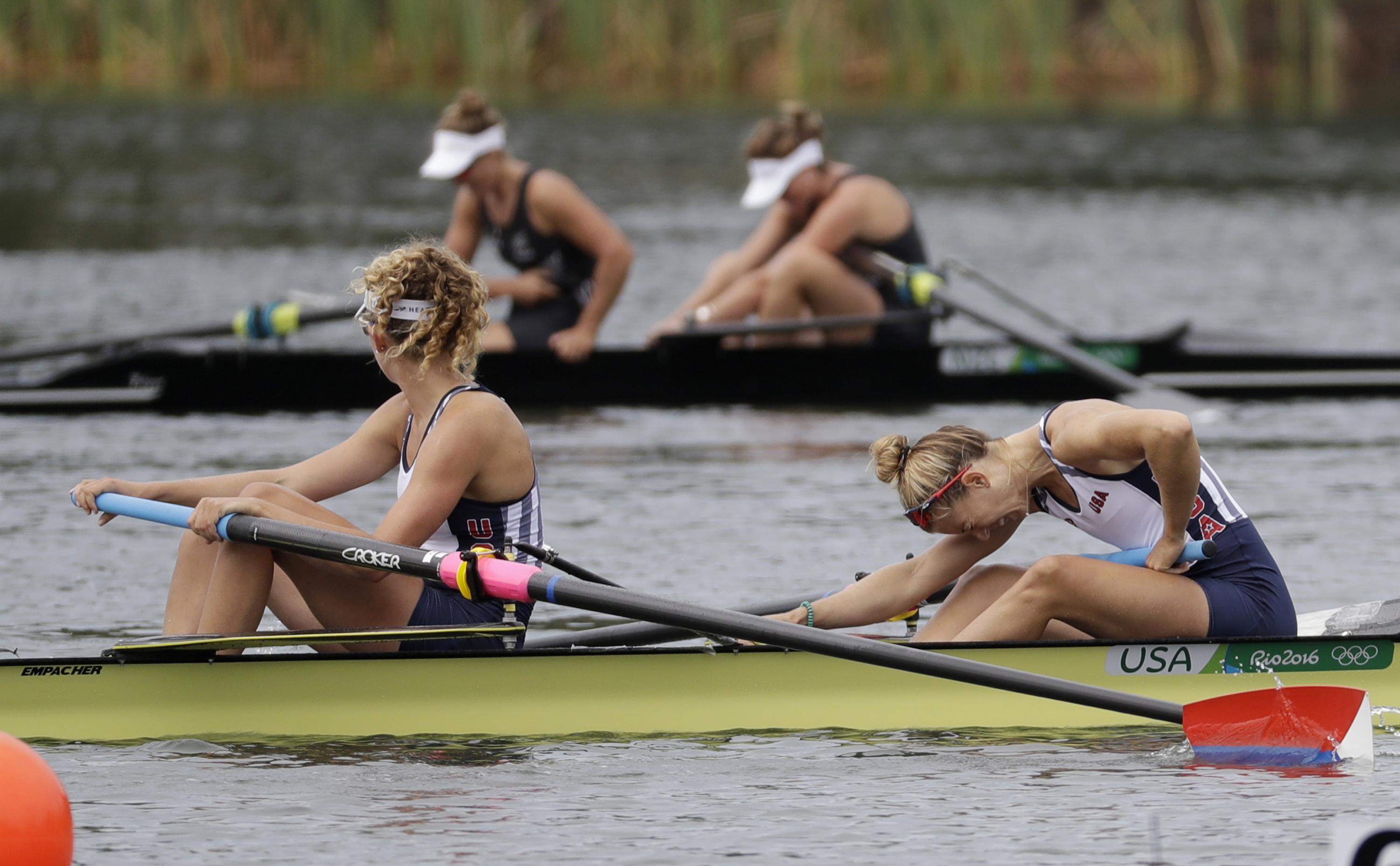 Felice Mueller and Grace Luczak, of United States, rest after competing in the women's rowing pair final during the 2016 Summer Olympics in Rio de Janeiro, Brazil, Friday, Aug. 12, 2016. (AP Photo/Luca Bruno)