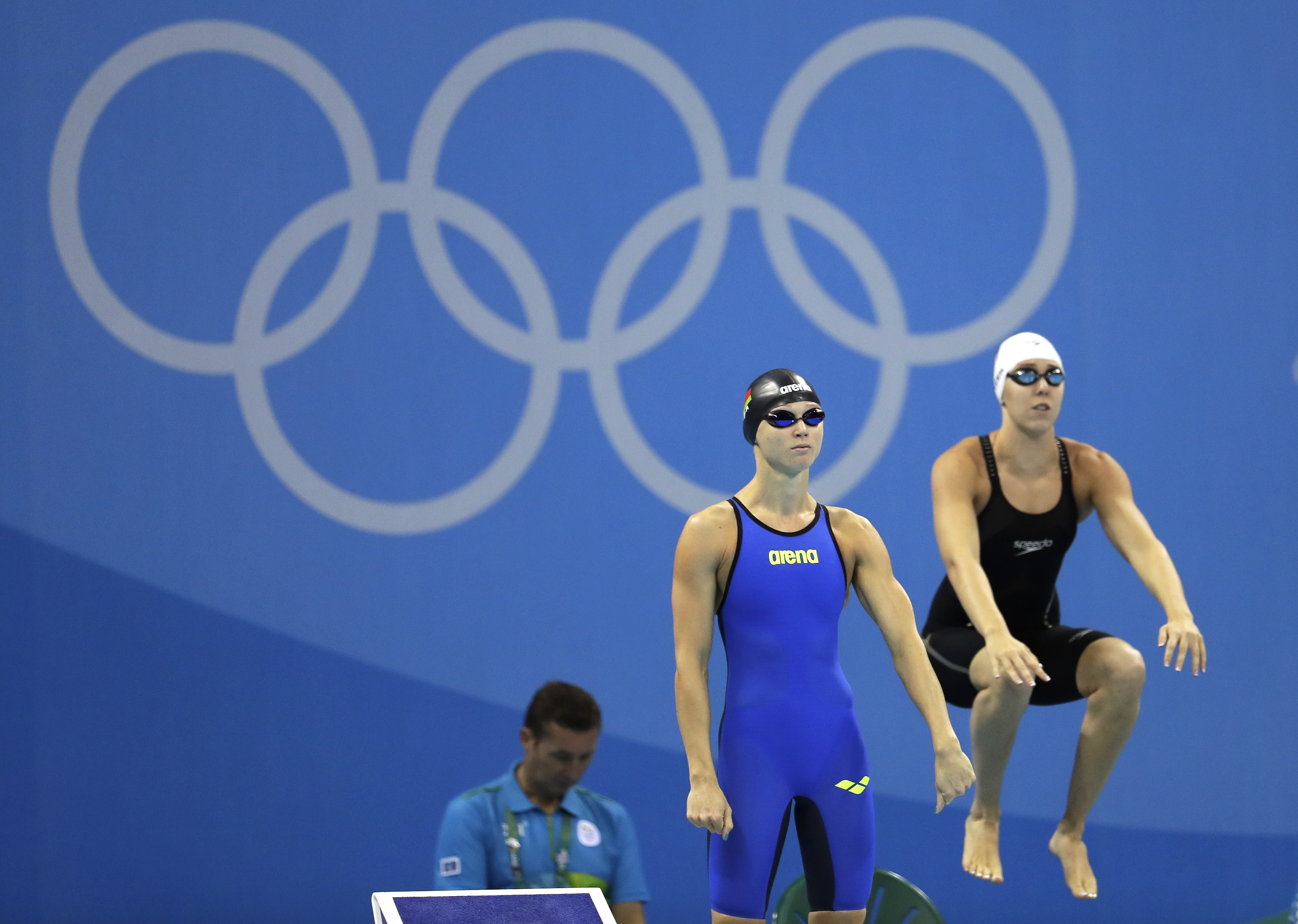 Belarus' Aliaksandra Herasimenia, left, and United States' Abbey Weitzeil prepare to start during a women's 50-meter freestyle heat during the swimming competitions at the 2016 Summer Olympics, Friday, Aug. 12, 2016, in Rio de Janeiro, Brazil. (AP Photo/N