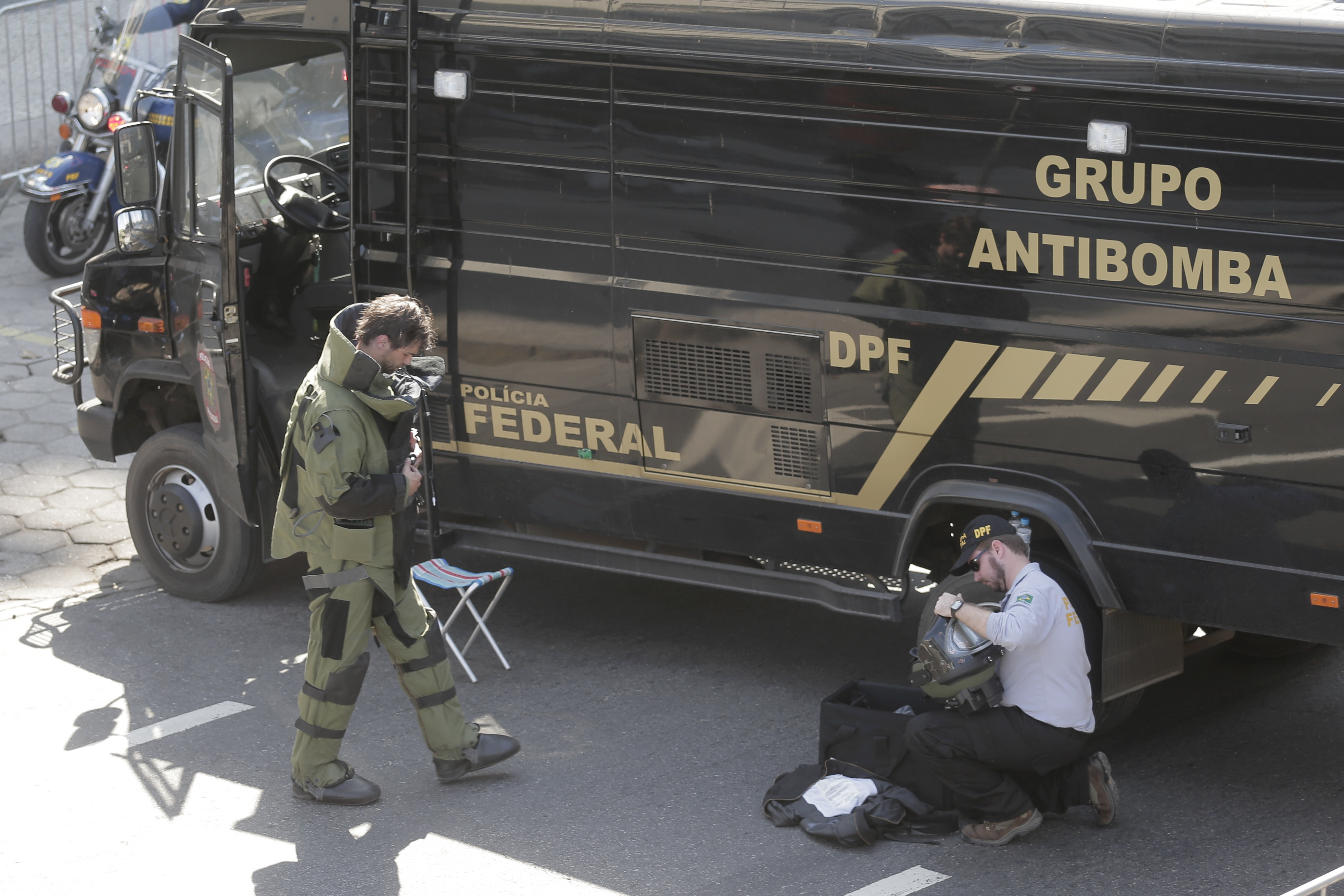 Members of Brazilian federal police bomb squad pack their gear after detonating a suspicious package near the men's cycling road race final on Copacabana beach at the 2016 Summer Olympics in Rio de Janeiro, Brazil, Saturday, Aug. 6, 2016. (AP Photo/Victor