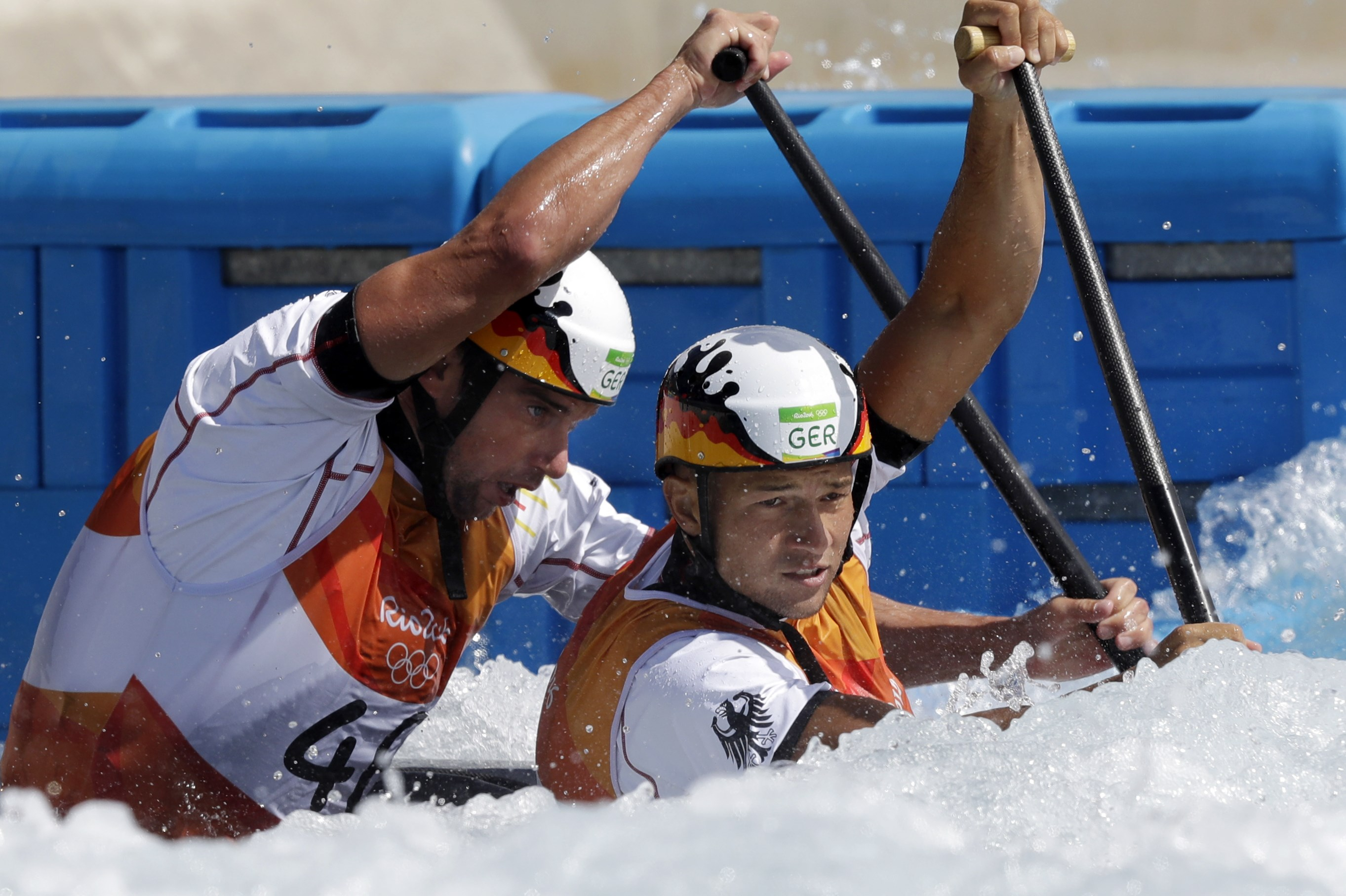 Franz Anton, front, and Jan Benzien of Germany paddle to a fourth place finish in canoe double C2 men's canoe slalom at the 2016 Summer Olympics in Rio de Janeiro, Brazil, Thursday, Aug. 11, 2016. (AP Photo/Robert F. Bukaty)
