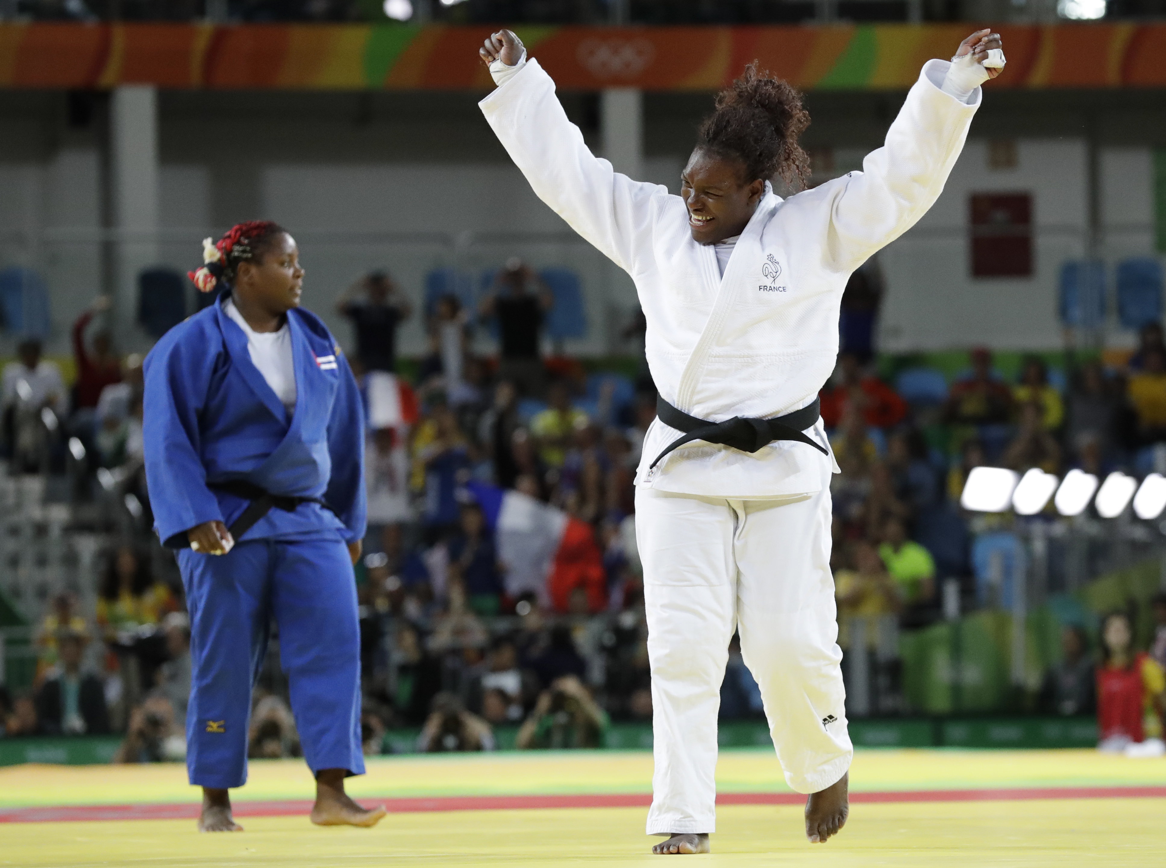 France's Emilie Andeol, right, reacts after defeating Cuba's Idalys Ortiz to win the gold medal during the women's +78 kg judo competition of the 2016 Summer Olympics in Rio de Janeiro, Brazil, Friday, Aug. 12, 2016. (AP Photo/Gregory Bull)
