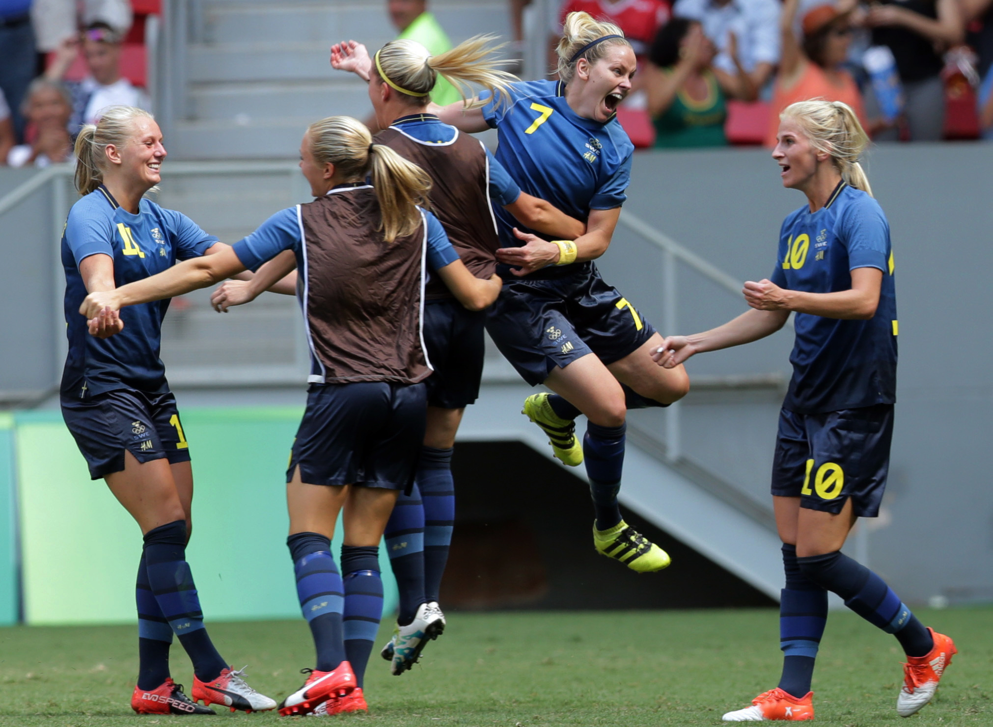 Players from Sweden celebrate after Stina Blackstenius, left, scored her team's first goal during a quarter-final match of the women's Olympic soccer tournament between the United States and Sweden in Brasilia Friday, Aug. 12, 2016. (AP Photo/Eraldo Peres