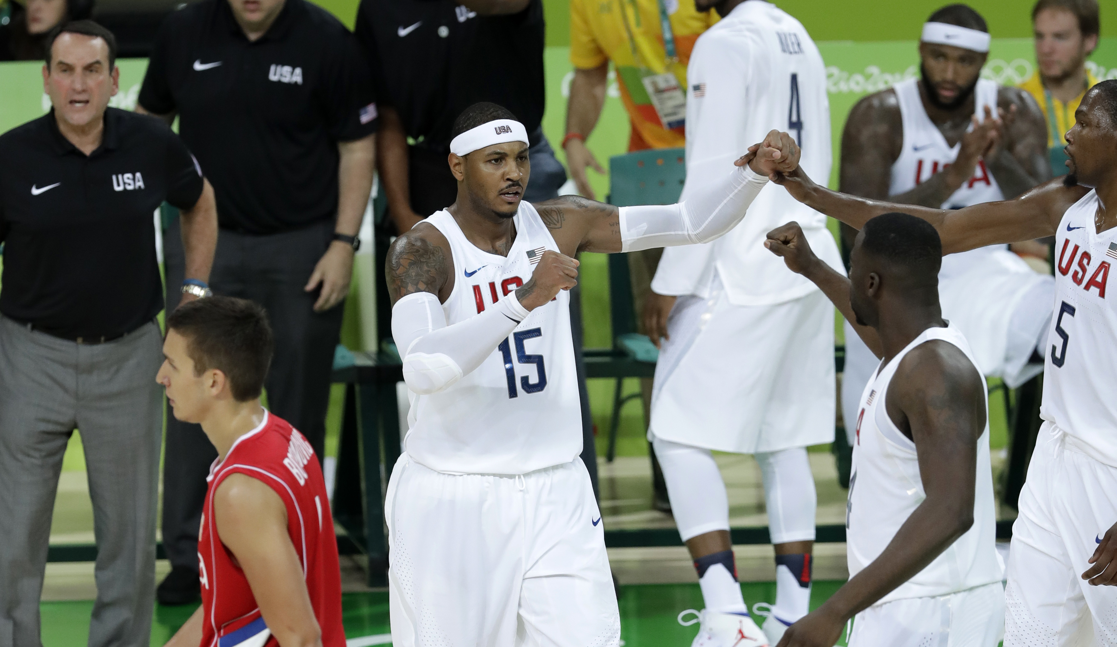United States' Carmelo Anthony (15) celebrates with teammates after making a basket during a basketball game against Serbia at the 2016 Summer Olympics in Rio de Janeiro, Brazil, Friday, Aug. 12, 2016. (AP Photo/Charlie Neibergall)