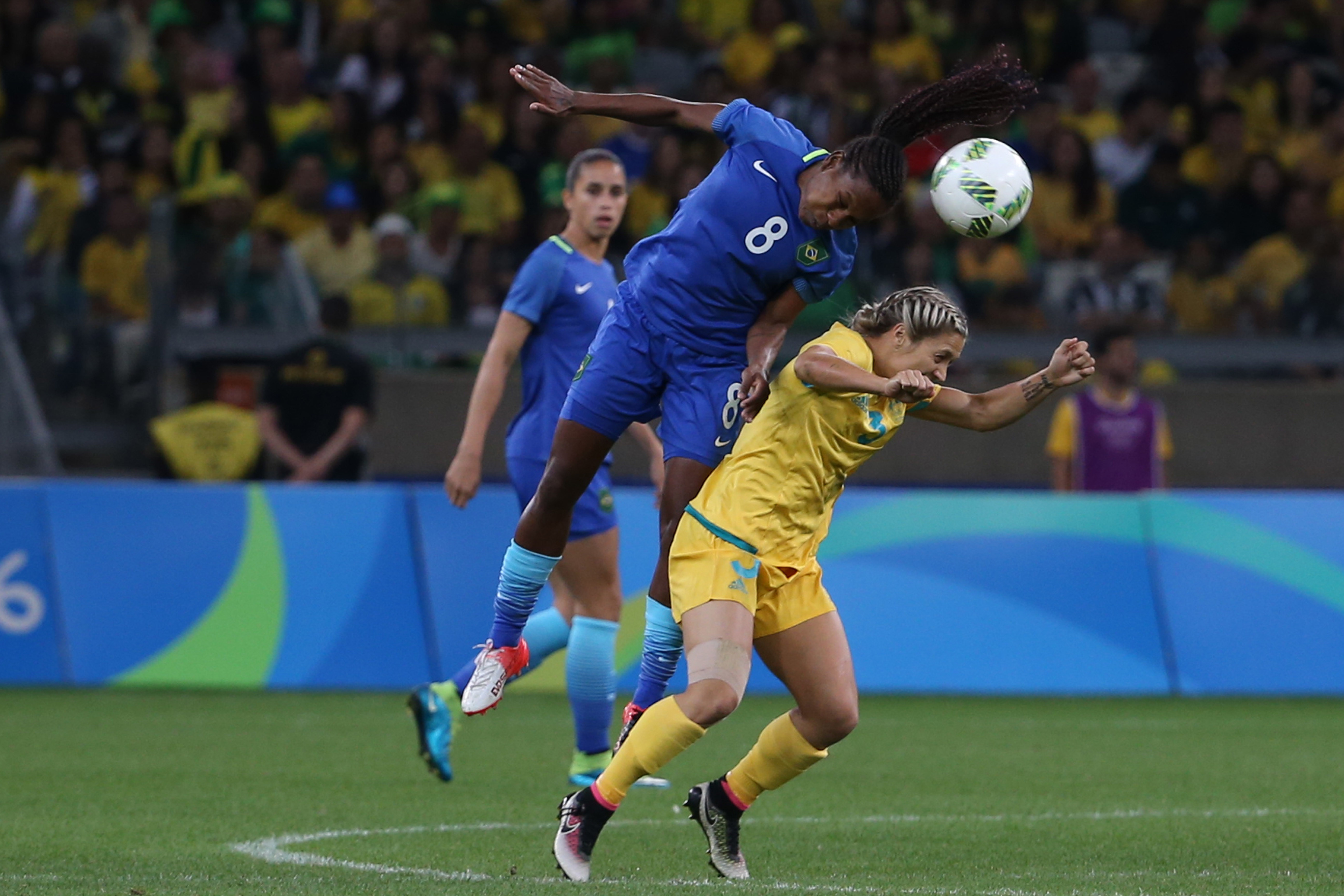 Brazil's Formiga, left, jumps for a header over Australia's Katrina Gorry during a quarter-final match of the women's Olympic football tournament between Brazil and Australia at the Mineirao Stadium in Belo Horizonte, Brazil, Friday Aug. 12, 2016. (AP Pho