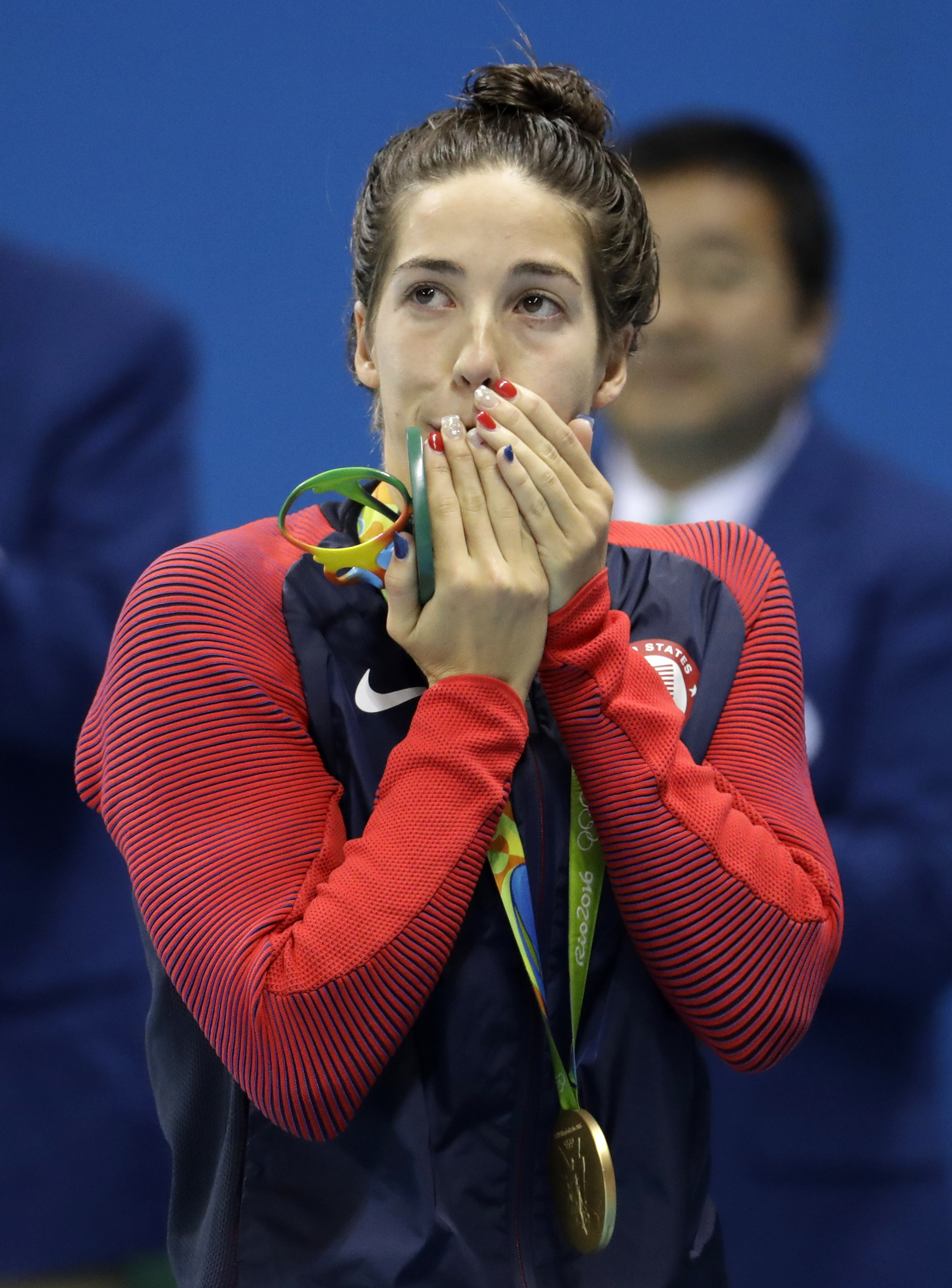 United States' Maya Dirado celebrates after winning gold in the women's 200-meter backstroke final during the swimming competitions at the 2016 Summer Olympics, Friday, Aug. 12, 2016, in Rio de Janeiro, Brazil. (AP Photo/Julio Cortez)