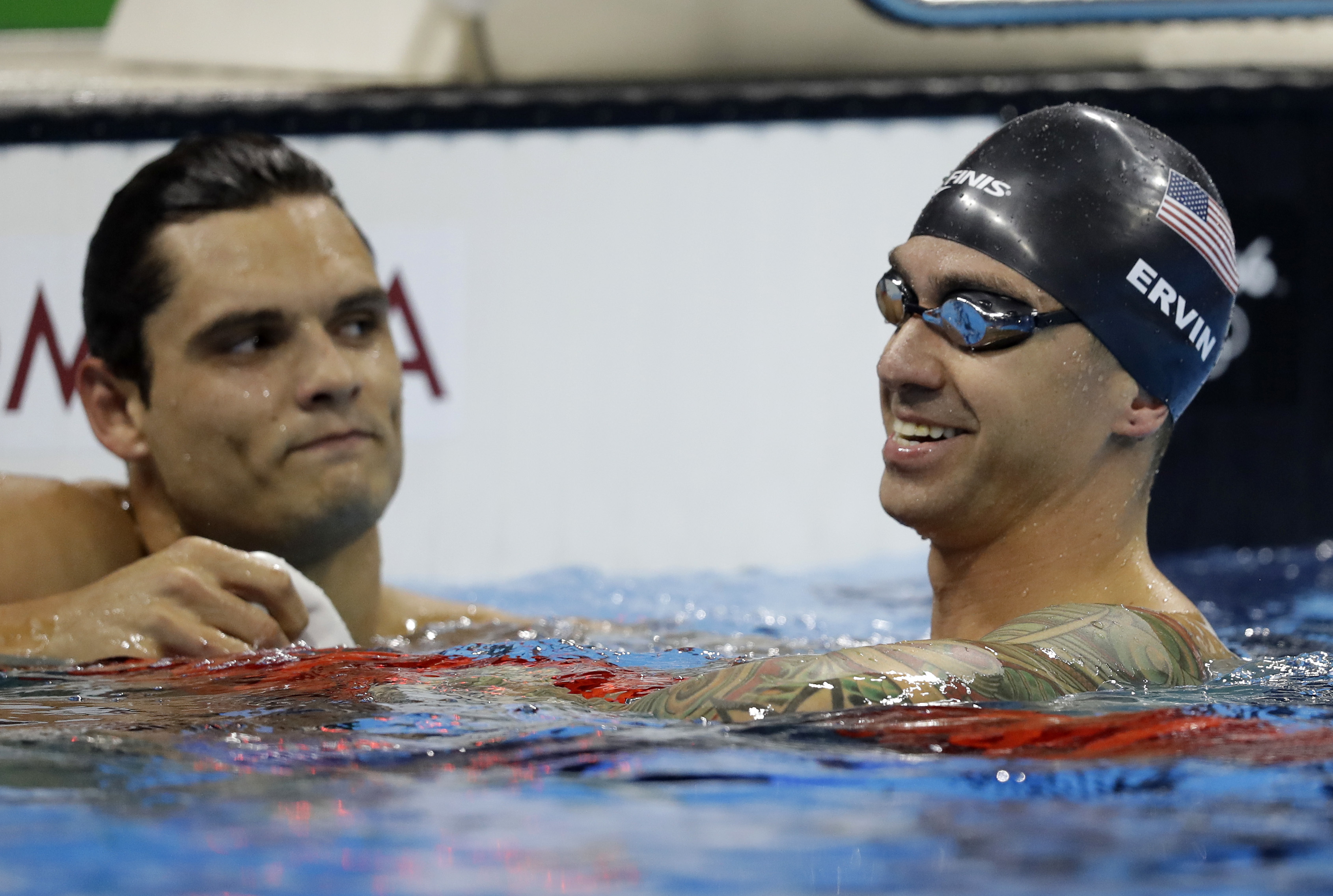 United States' Anthony Ervin, right, smiles as France's Florent Manaudou looks on after the men's 50-meter freestyle final during the swimming competitions at the 2016 Summer Olympics, Friday, Aug. 12, 2016, in Rio de Janeiro, Brazil. (AP Photo/Michael So