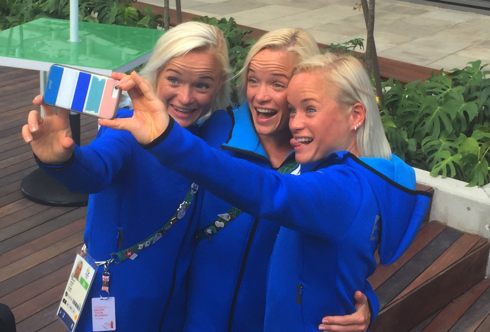 In this Friday, Aug. 12, 2016 photo, Estonian triplets, from left, Leila, Liina and Lily Luik take a selfie outside the Main Press Center at the 2016 Summer Olympics in Rio de Janeiro, Brazil. Olympic spectators face the challenge Sunday, Aug. 14 of tryin