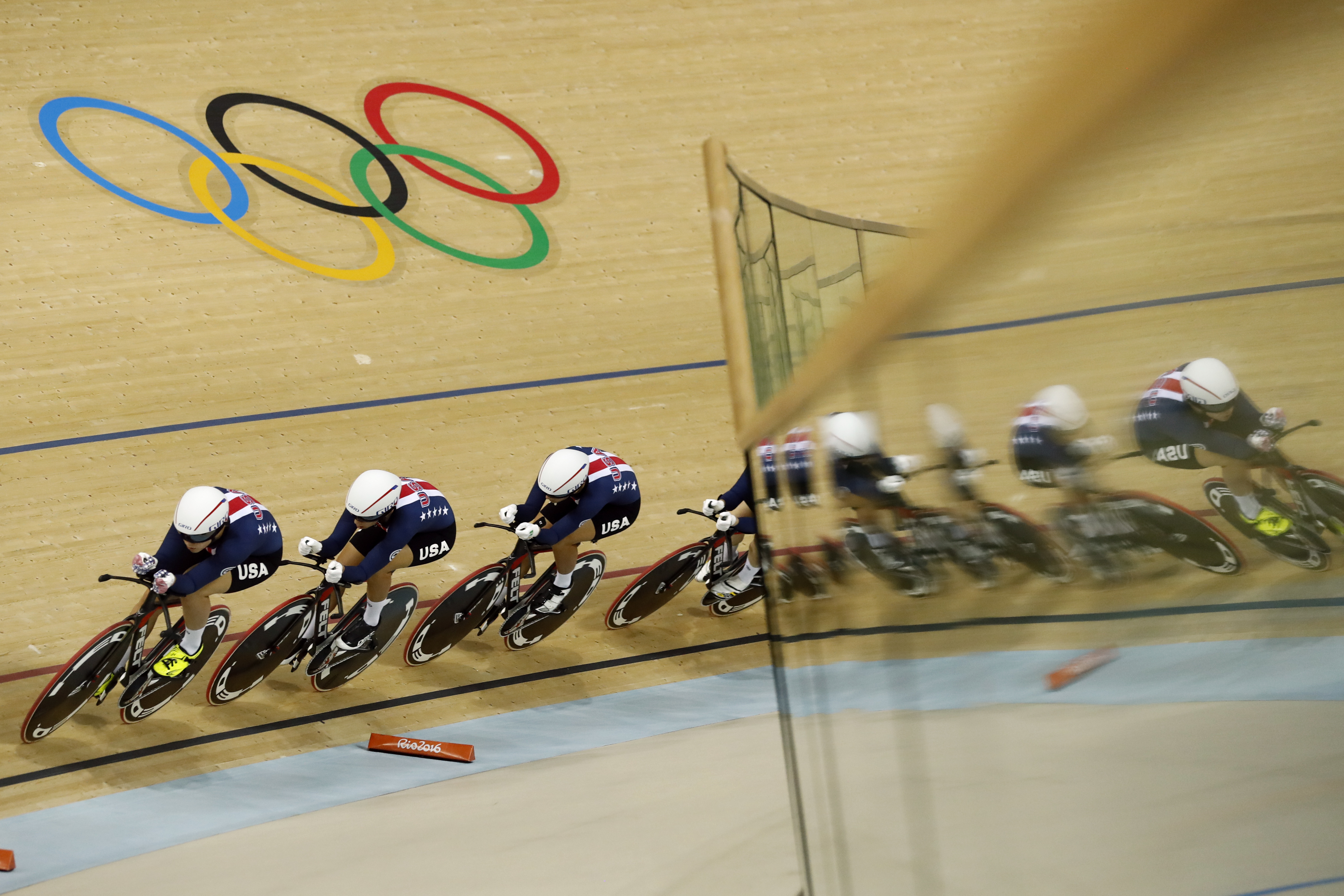 United States' team competes in the women's team pursuit first round at the Rio Olympic Velodrome during the 2016 Summer Olympics in Rio de Janeiro, Brazil, Saturday, Aug. 13, 2016. (AP Photo/Patrick Semansky)