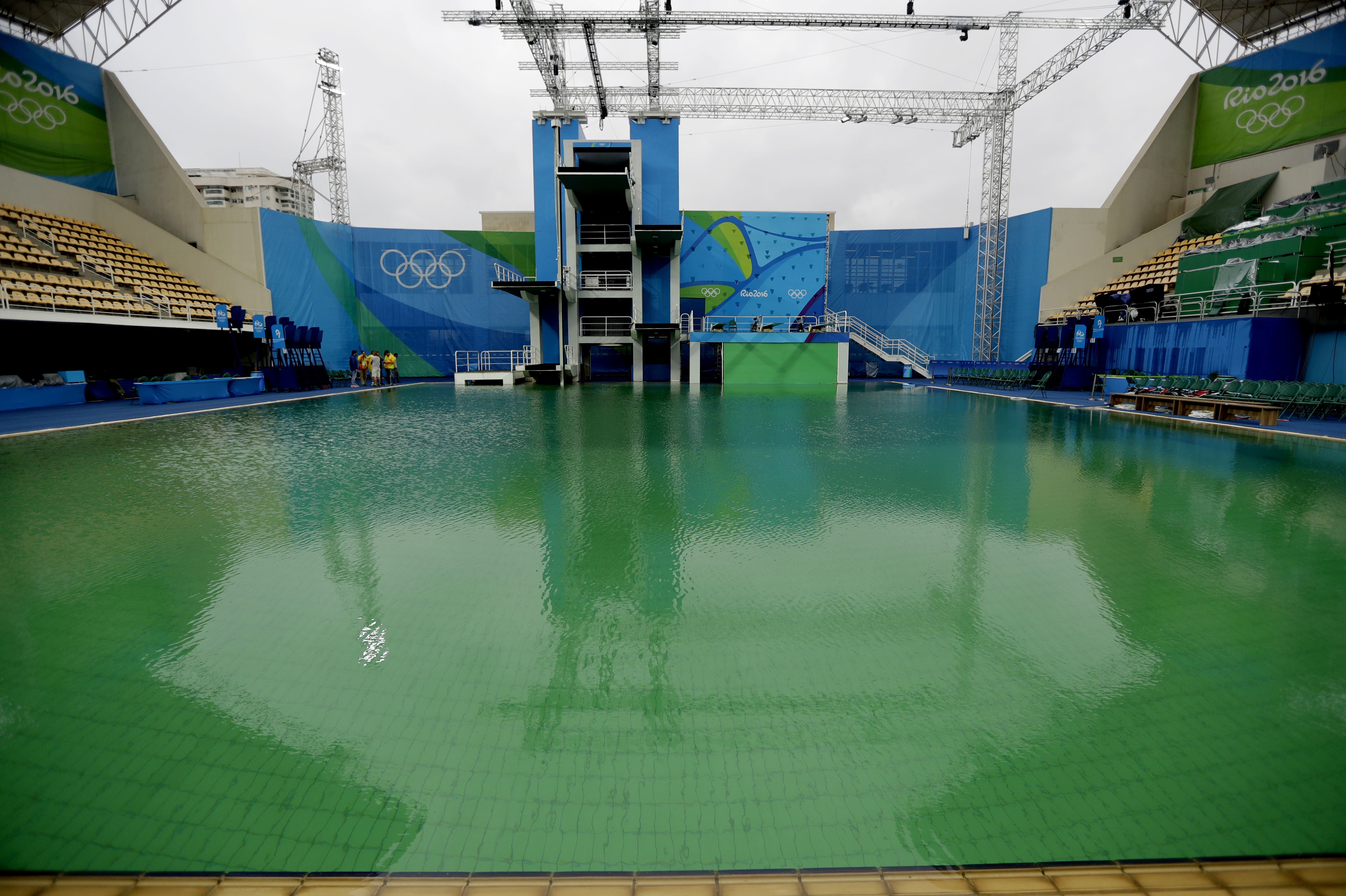 The water of the diving pool appears a murky green in the Maria Lenk Aquatic Center at the 2016 Summer Olympics in Rio de Janeiro, Brazil, Wednesday, Aug. 10, 2016. (AP Photo/Matt Dunham)