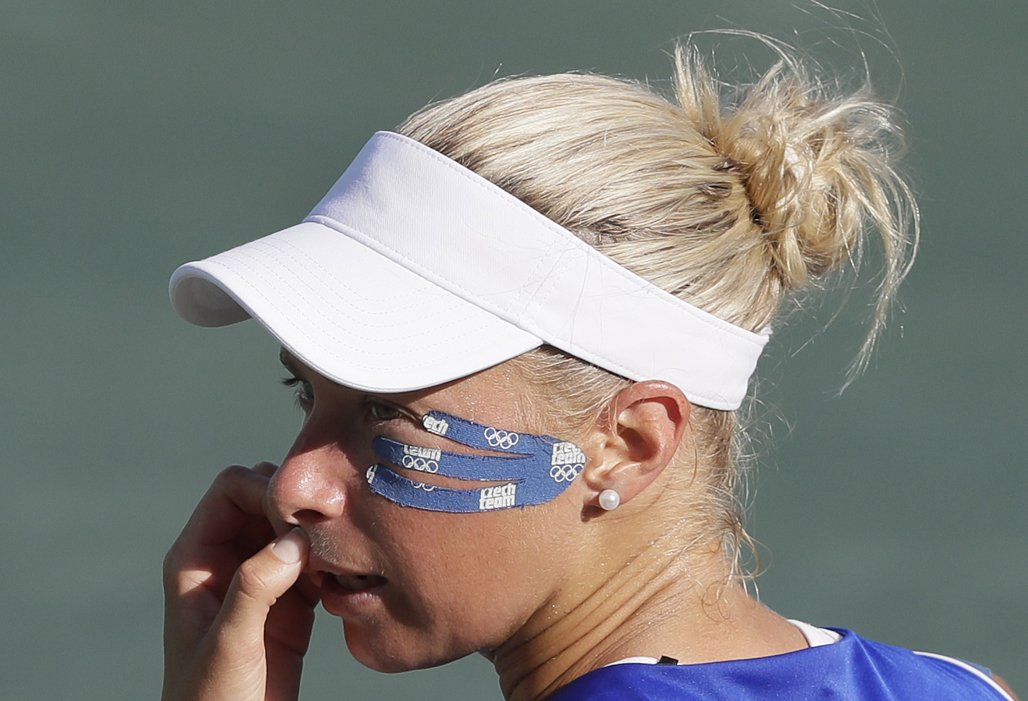 Tape around the eye of Andrea Hlavackova as she plays with partner Lucie Hradecka against Lucie Safarova and Barbora Strycova all of the Czech Republic during their women's doubles bronze medal tennis match at the 2016 Summer Olympics in Rio de Janeiro, B