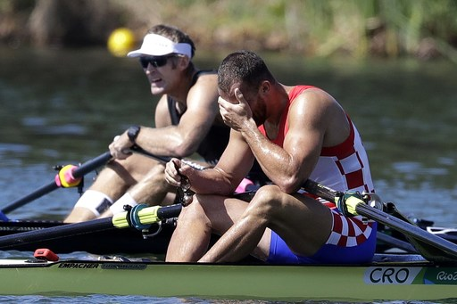 Silver medalist Damir Martin, of Croatia, right, reacts as gold medalist Mahe Drysdale, of New Zealand, rests after the men's rowing single sculls final during the 2016 Summer Olympics in Rio de Janeiro, Brazil, Saturday, Aug. 13, 2016. Martin took the si