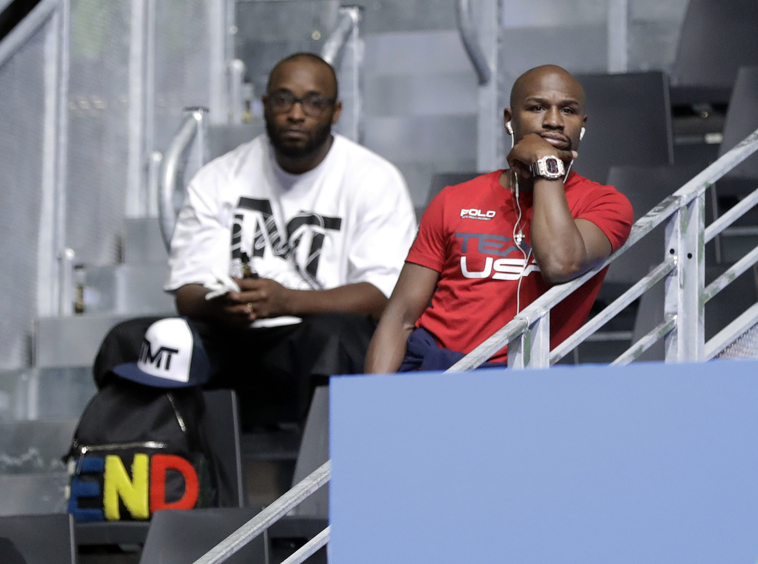 Boxer Floyd Mayweather Jr., right, watches boxing matches at Riocentro during the 2016 Summer Olympics in Rio de Janeiro, Brazil, Saturday, Aug. 13, 2016. (AP Photo/Frank Franklin II)