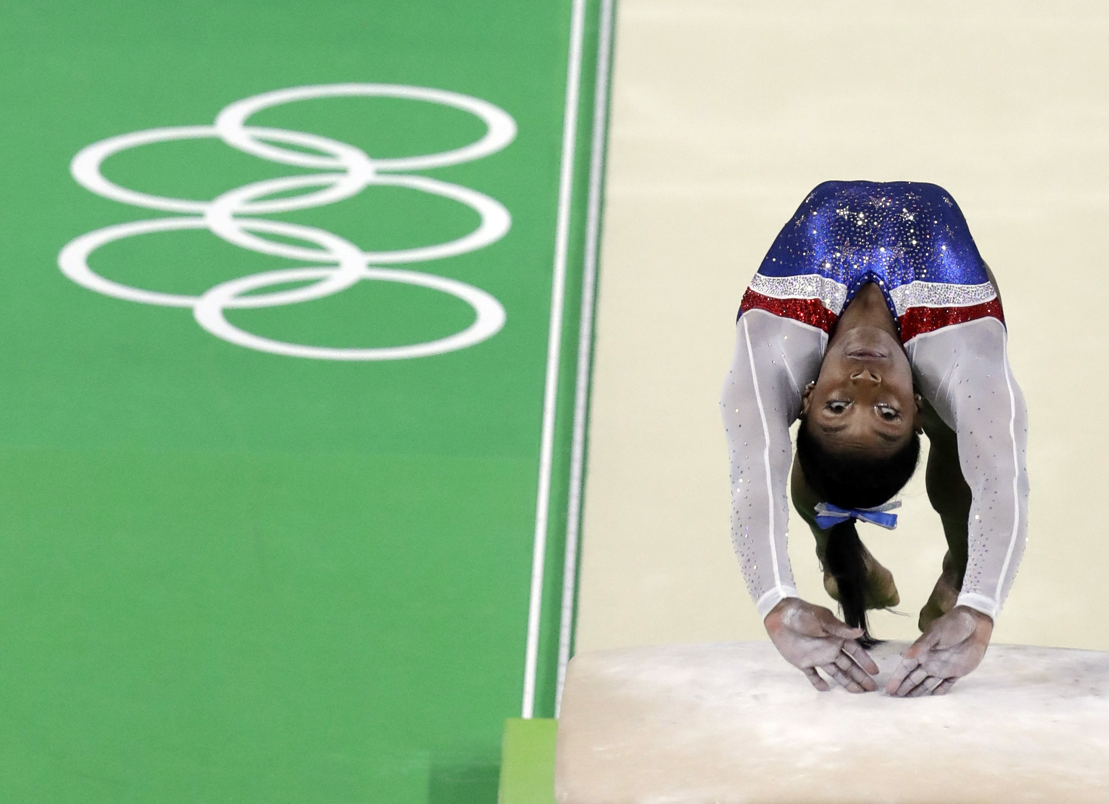 FILE - In this Aug. 11. 2016 file photo, United States' Simone Biles performs on the vault during the artistic gymnastics women's individual all-around final at the 2016 Summer Olympics in Rio de Janeiro, Brazil. Biles goes for her third gold in Rio when
