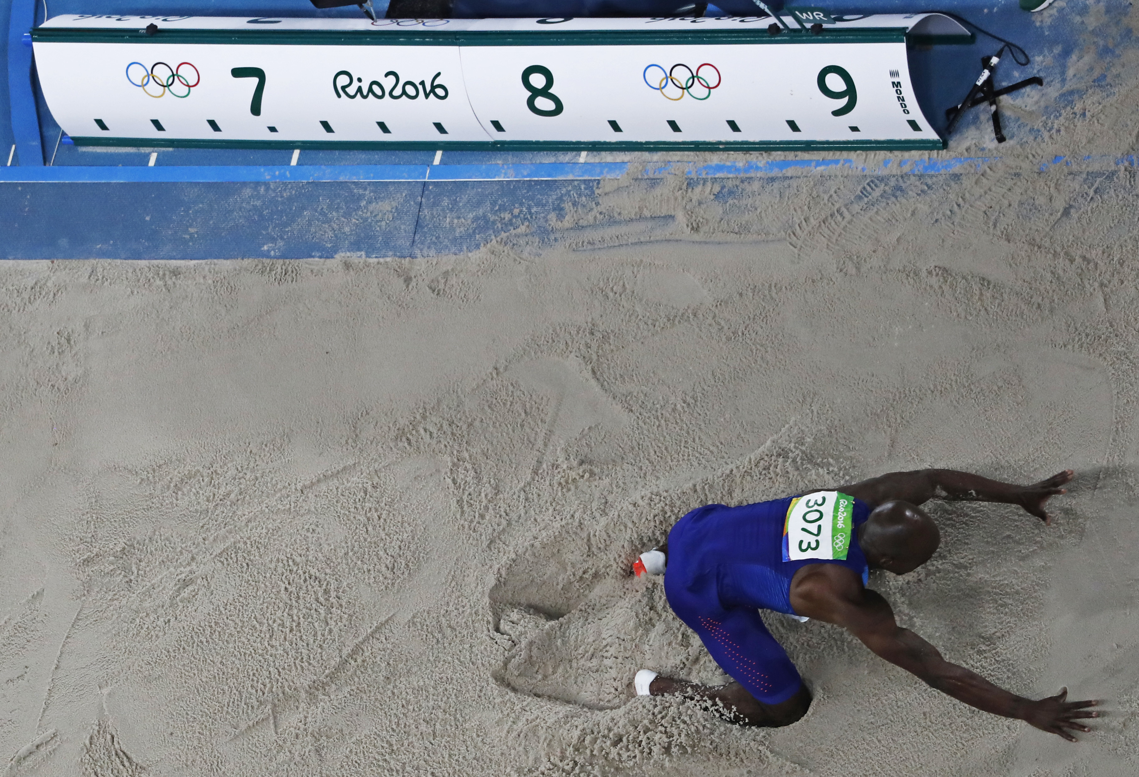 United States' Jeff Henderson lands after an attempt in the long jump finals during the athletics competitions of the 2016 Summer Olympics at the Olympic stadium in Rio de Janeiro, Brazil, Saturday, Aug. 13, 2016. (AP Photo/Morry Gash)
