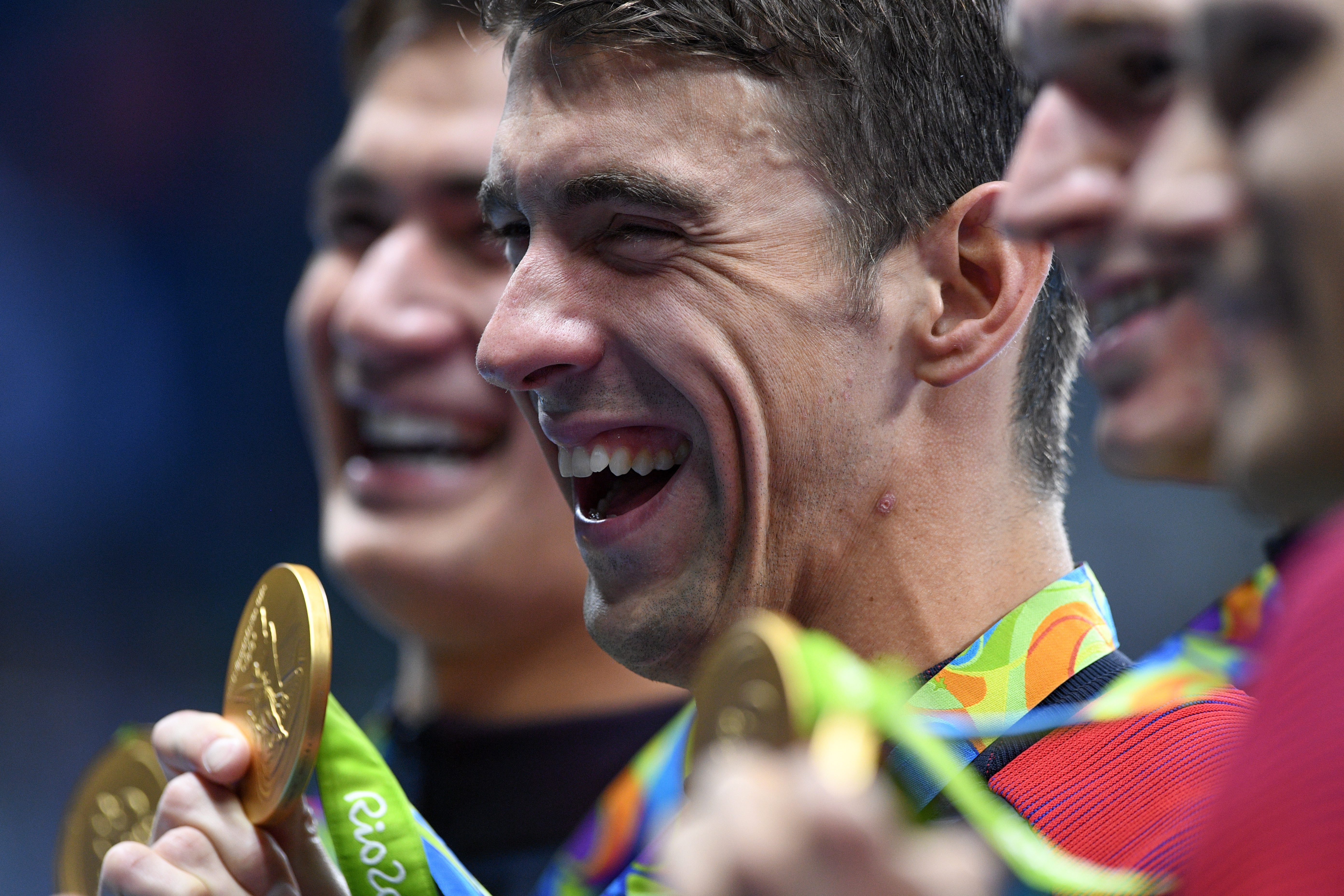 United States' Michael Phelps celebrates with teammates during the medal ceremony for the men's 4 x 100-meter medley relay final during the swimming competitions at the 2016 Summer Olympics, Sunday, Aug. 14, 2016, in Rio de Janeiro, Brazil. (Sean Kilpatri
