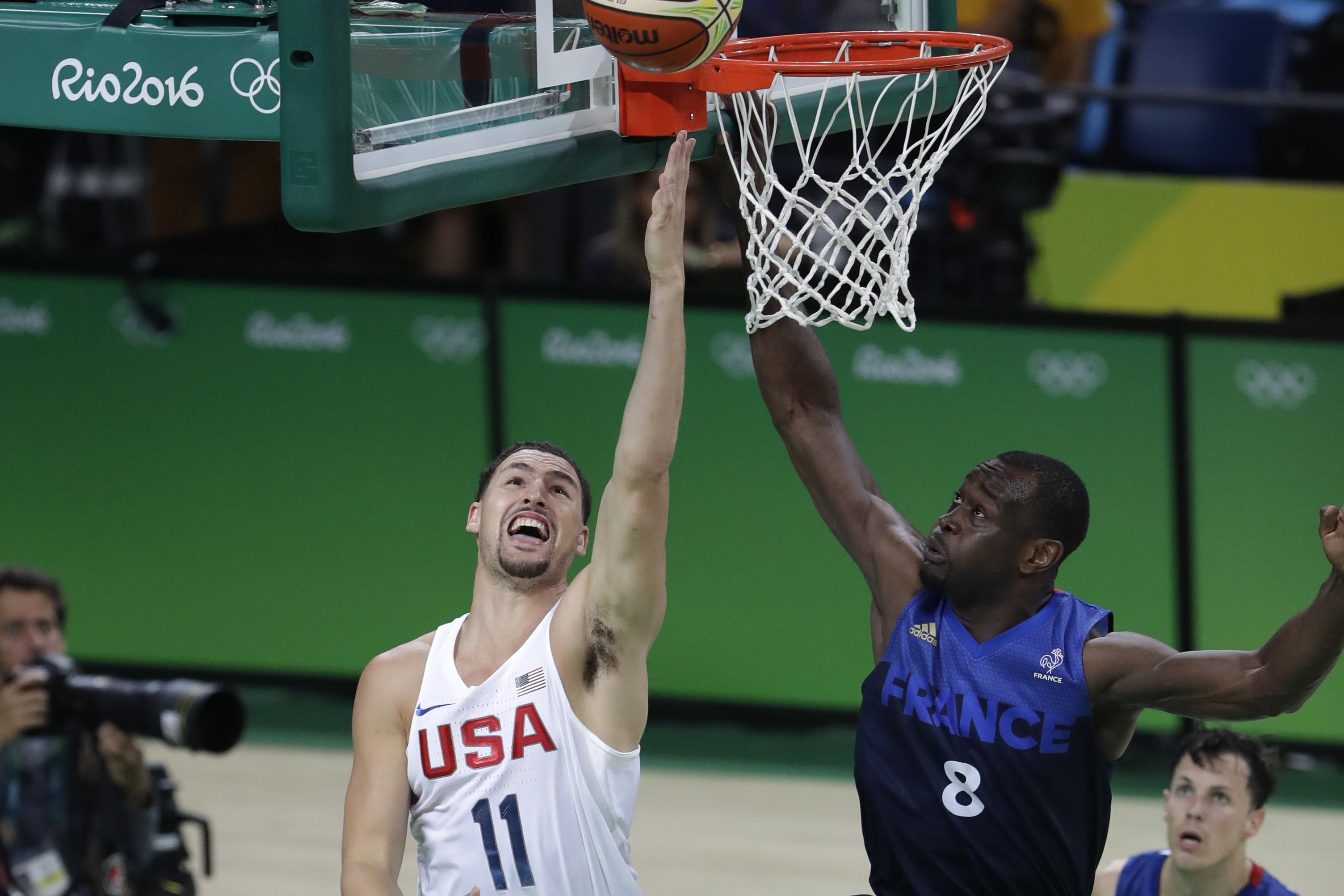 United States' Klay Thompson (11) drives to the basket against France's Charles Kahudi (8) during a men's basketball game at the 2016 Summer Olympics in Rio de Janeiro, Brazil, Sunday, Aug. 14, 2016. (AP Photo/Eric Gay)