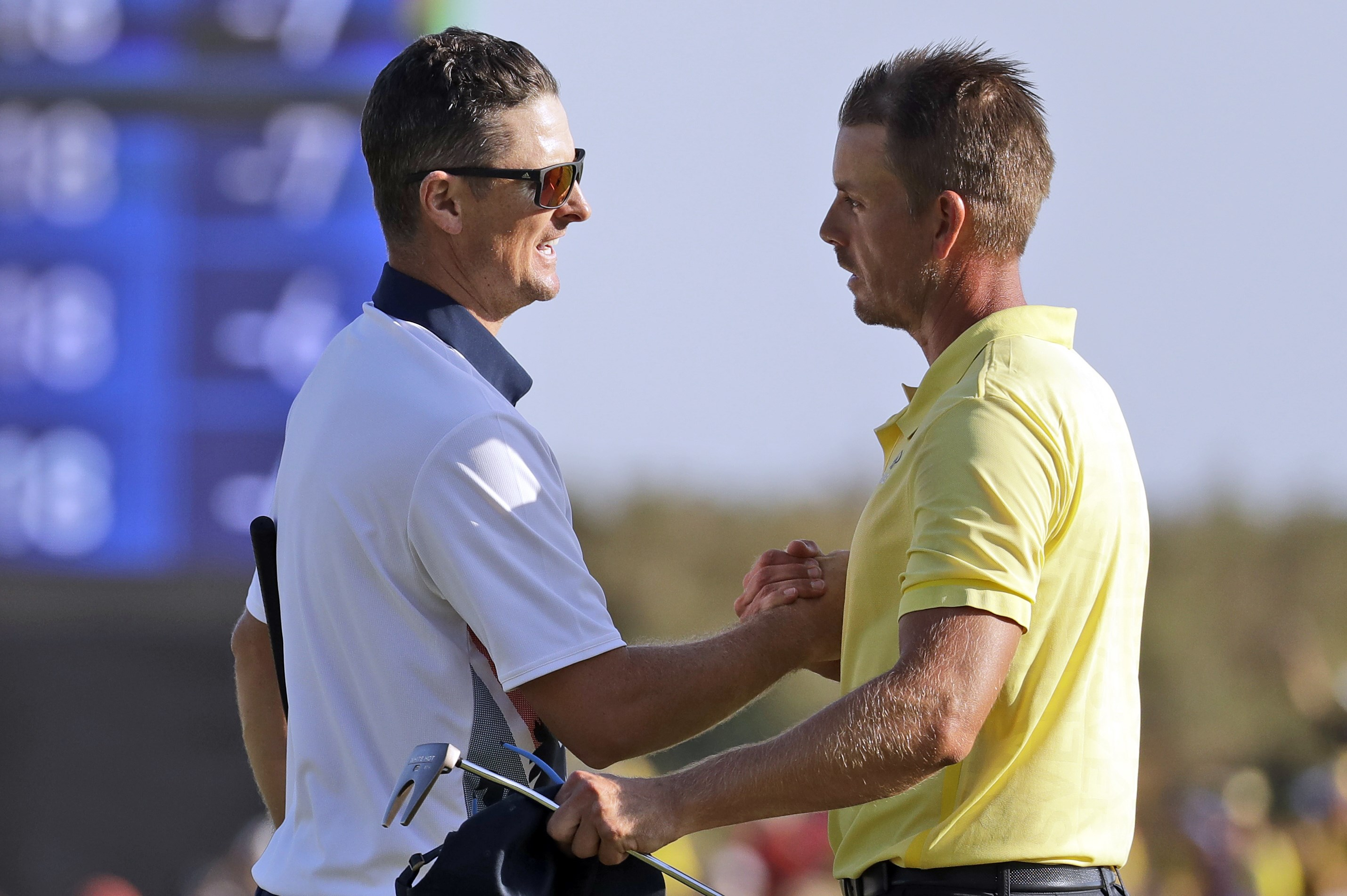 Justin Rose of Great Britain, left, and Henrik Stenson of Sweden, shake hands after Rose won gold and Stenson won silver during the final round of the men's golf event at the 2016 Summer Olympics in Rio de Janeiro, Brazil, Sunday, Aug. 14, 2016. (AP Photo