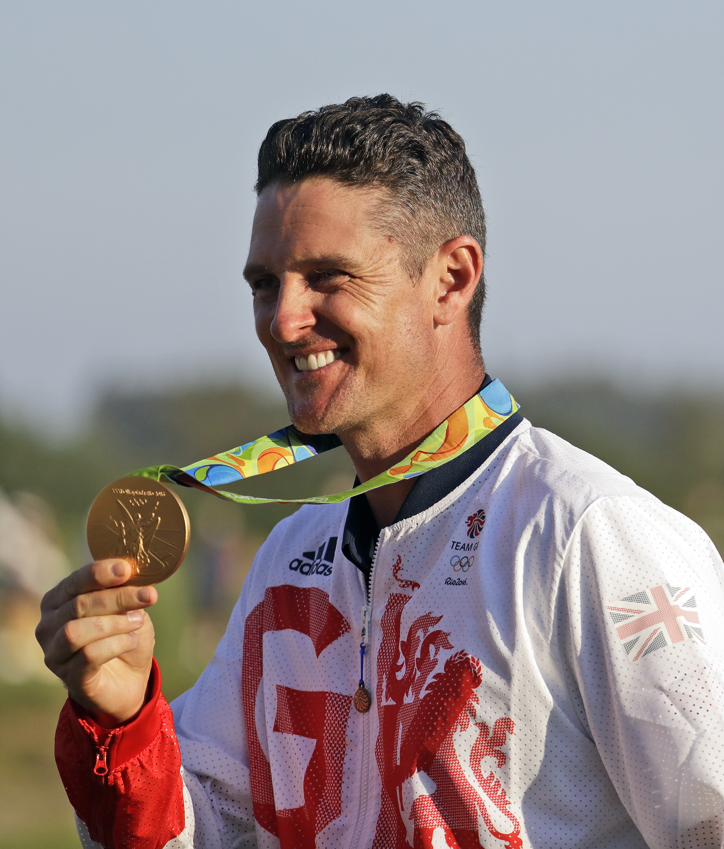 Justin Rose of Great Britain, holds up the gold medal after during the final round of the men's golf event at the 2016 Summer Olympics in Rio de Janeiro, Brazil, Sunday, Aug. 14, 2016. (AP Photo/Chris Carlson)