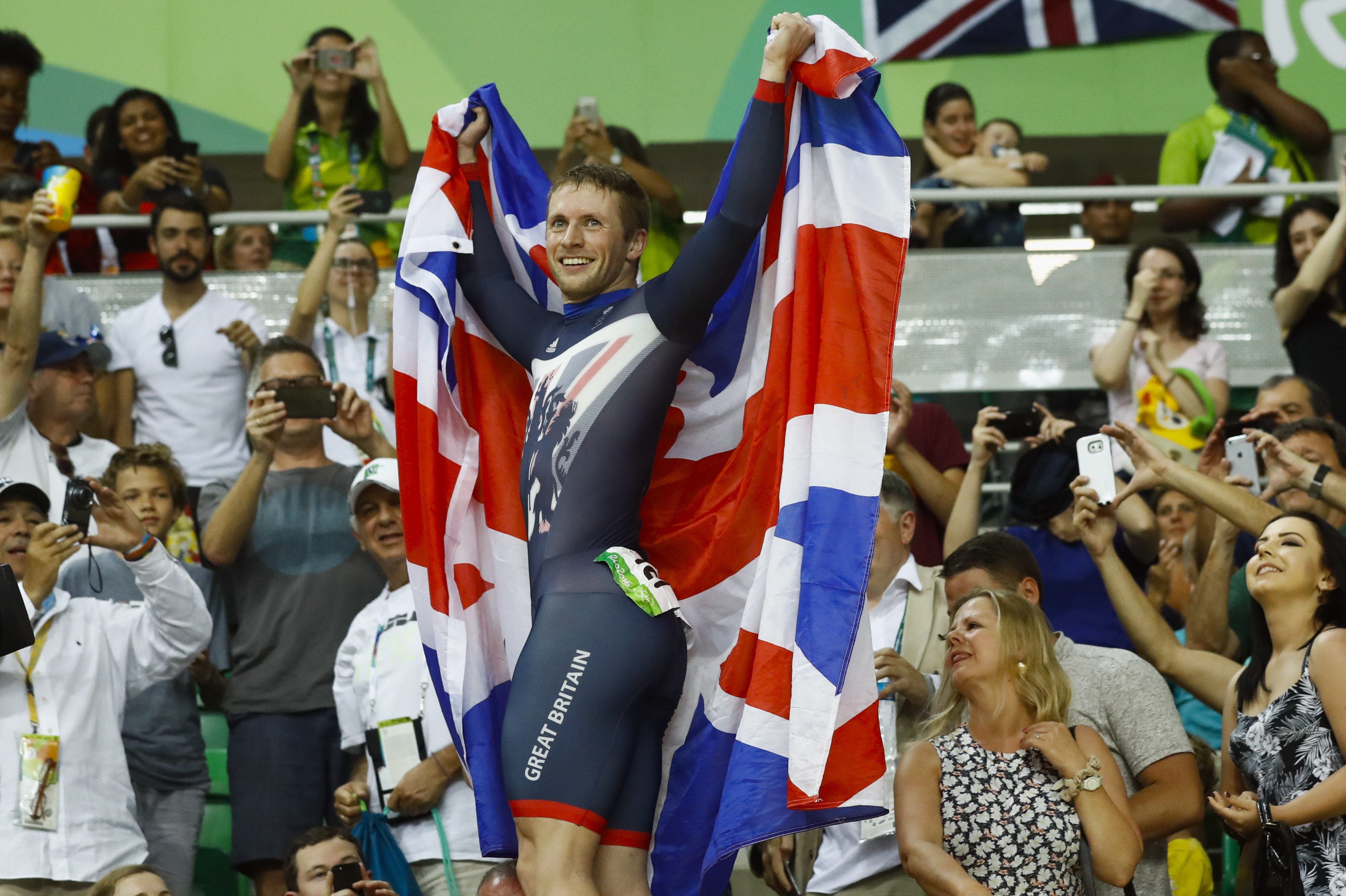 Jason Kenny of Britain celebrates after winning gold in the men's cycling sprint final at the Rio Olympic Velodrome during the 2016 Summer Olympics in Rio de Janeiro, Brazil, Sunday, Aug. 14, 2016. (AP Photo/Patrick Semansky)