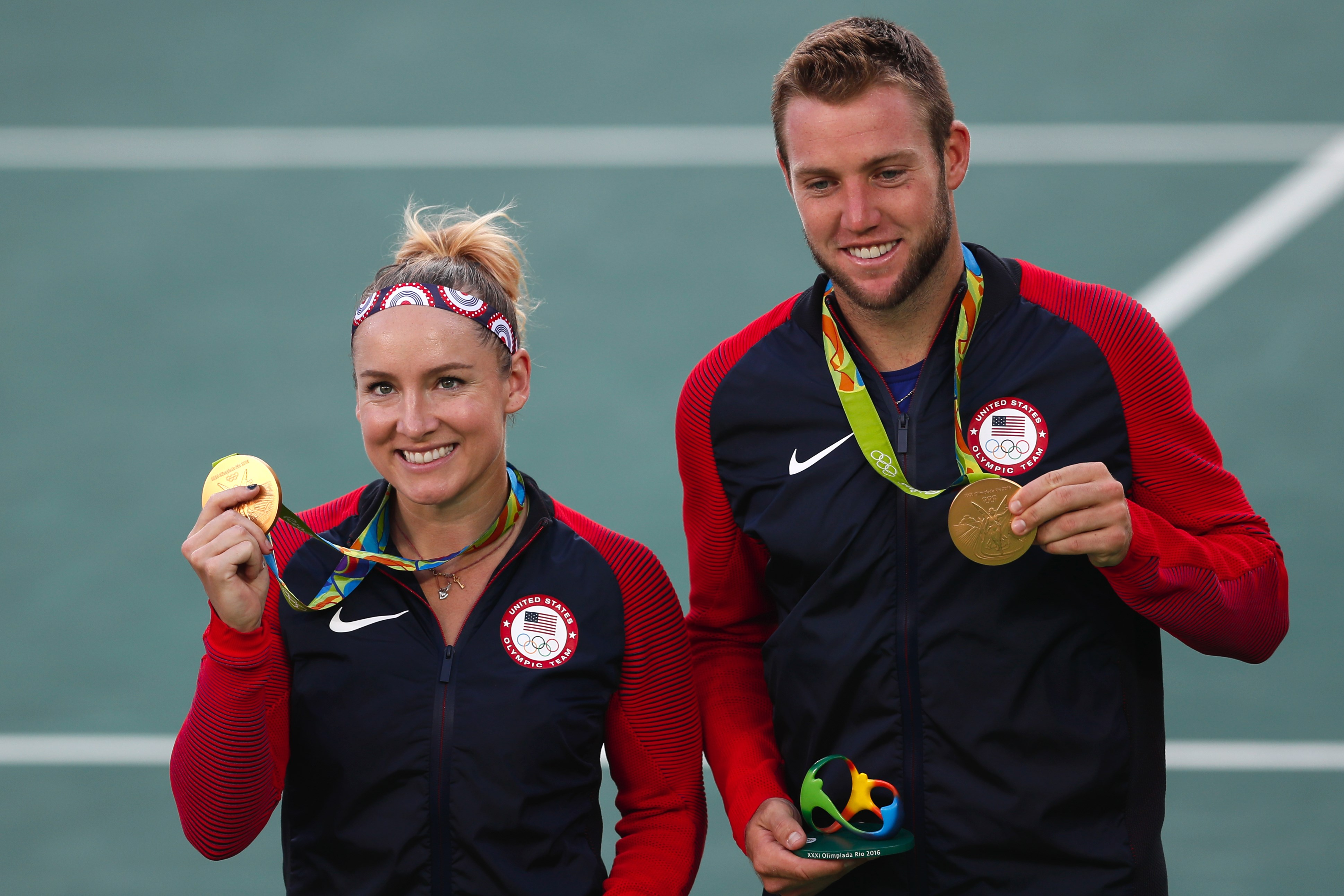 Gold medalists Bethanie Mattek-Sands, of the United States, and partner Jack Sock, pose with their medals during the medals ceremony of the mixed doubles tennis competition at the 2016 Summer Olympics in Rio de Janeiro, Brazil, Sunday, Aug. 14, 2016. Venu