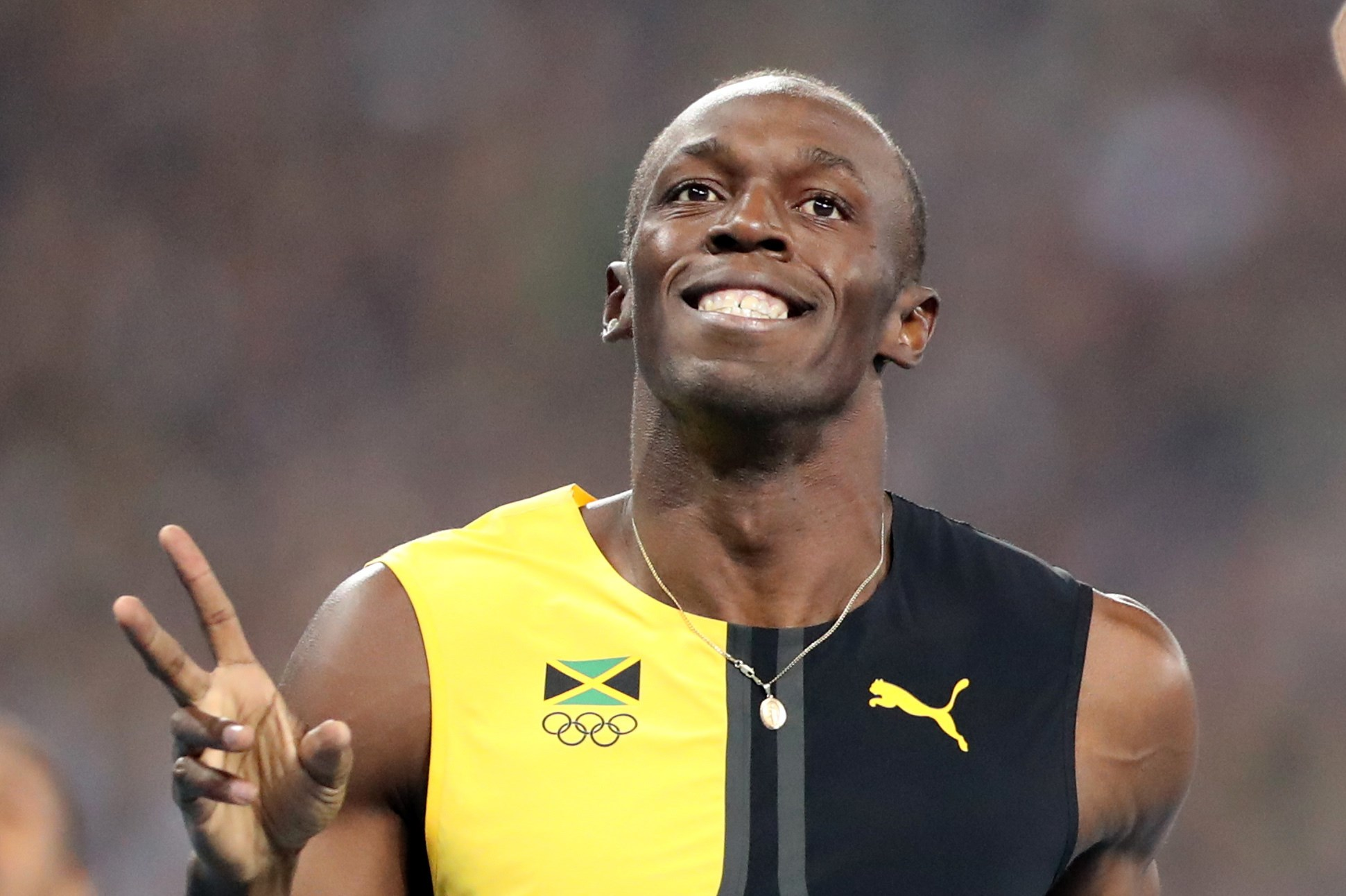Jamaica's Usain Bolt celebrates as he crosses the line to win gold in the men's 100-meter final during the athletics competitions of the 2016 Summer Olympics at the Olympic stadium in Rio de Janeiro, Brazil, Sunday, Aug. 14, 2016. (AP Photo/Lee Jin-man)