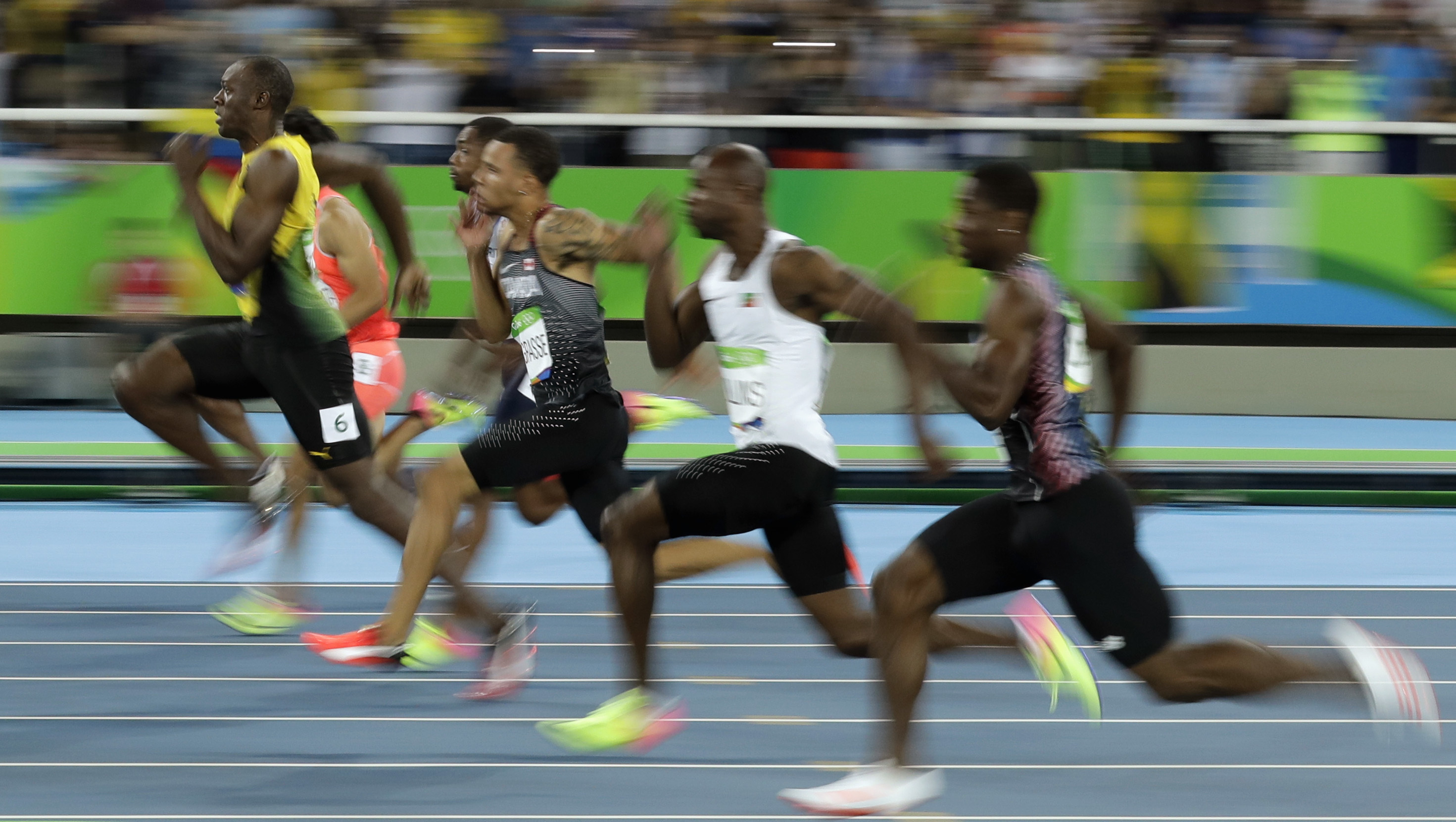 Jamaica's Usain Bolt, left, takes the lead in a men's 100-meter semifinal during the athletics competitions of the 2016 Summer Olympics at the Olympic stadium in Rio de Janeiro, Brazil, Sunday, Aug. 14, 2016. (AP Photo/Matt Dunham)