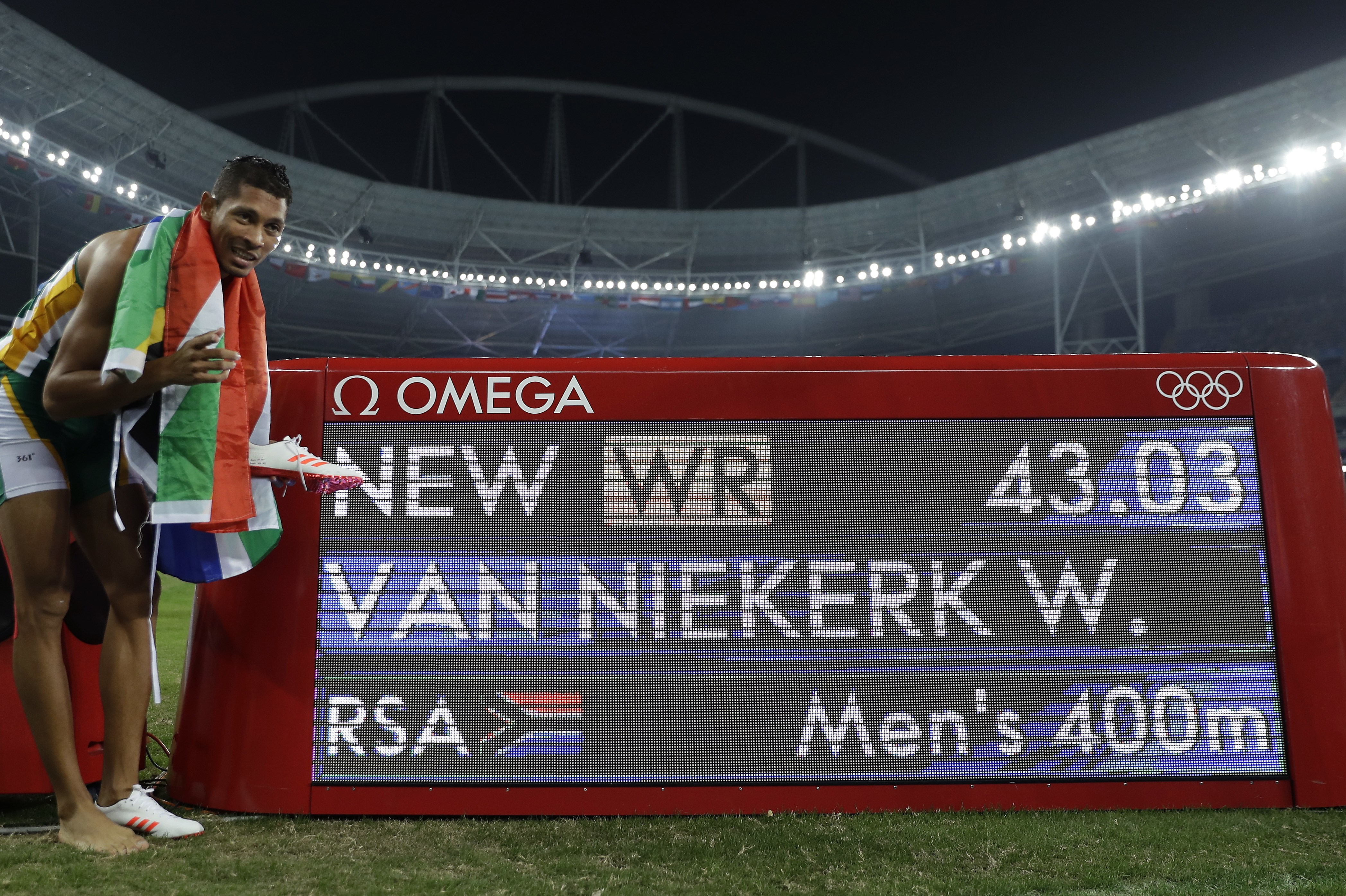 South Africa's Wayde Van Niekerk celebrates after winning the gold medal during the athletics competitions in the Olympic stadium of the 2016 Summer Olympics in Rio de Janeiro, Brazil, Sunday, Aug. 14, 2016. (AP Photo/Matt Slocum)