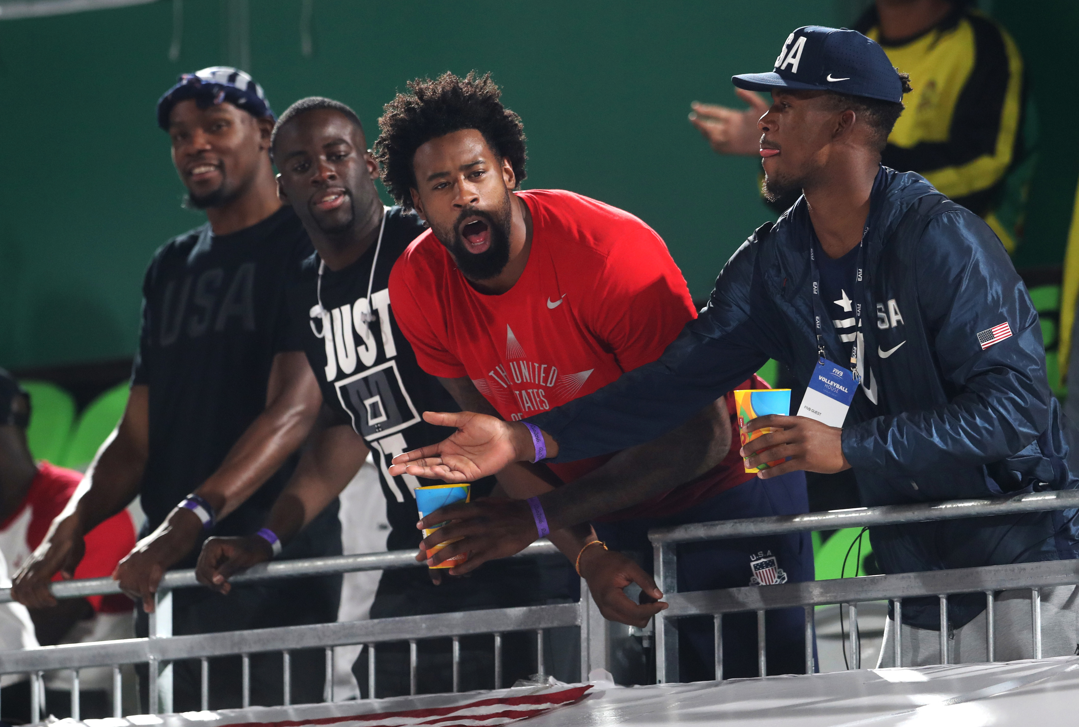 Members of United States' basketball team, from left, Kevin Durant, Draymond Green, DeAndre Jordan and Jimmy Butler cheer during a women's beach volleyball quarterfinal match between United States and Australia at the 2016 Summer Olympics in Rio de Janeir