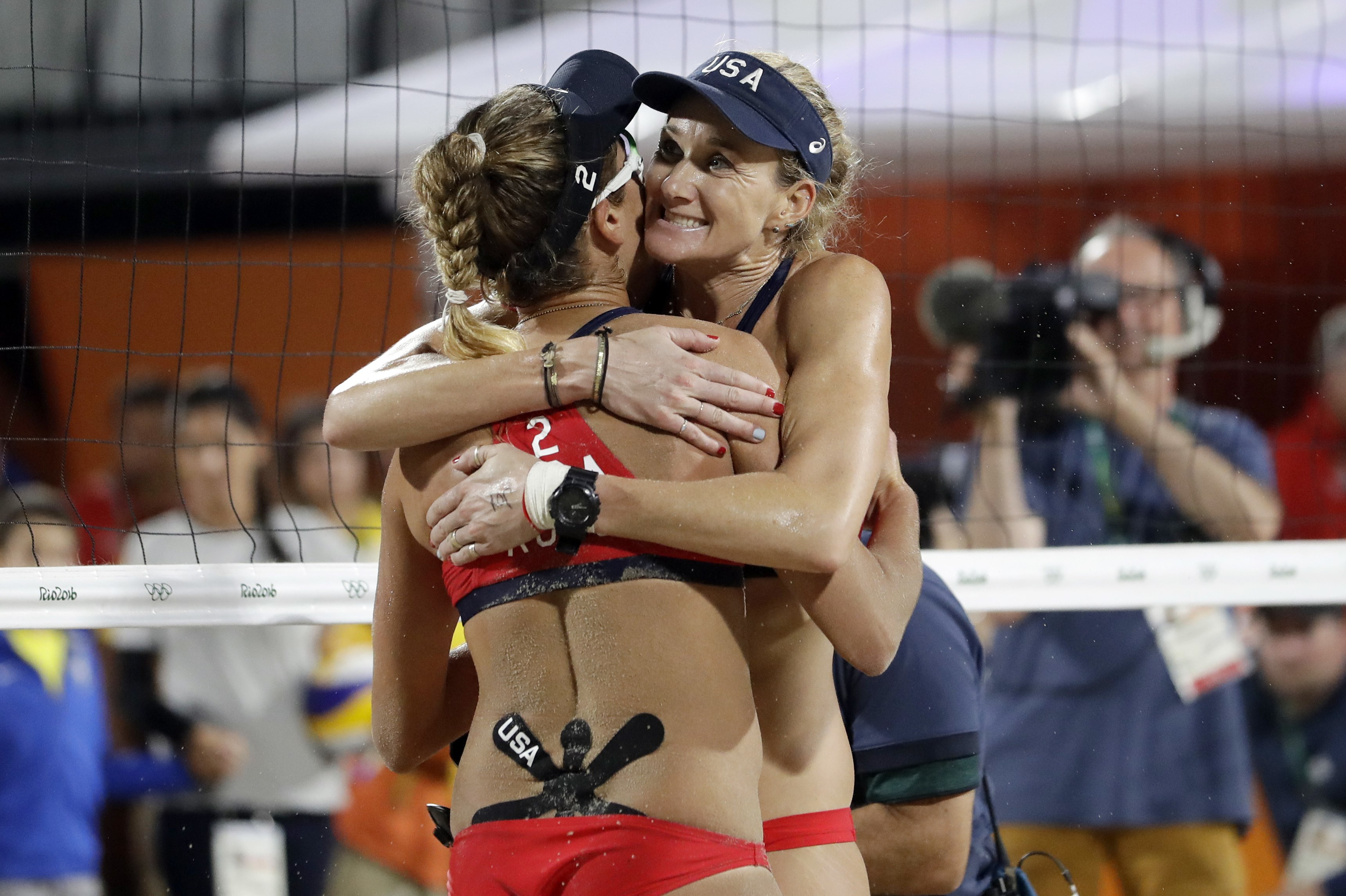 United States' Kerri Walsh Jennings, right, hugs teammate April Ross after beating Australia during a women's beach volleyball quarterfinal match at the 2016 Summer Olympics in Rio de Janeiro, Brazil, Monday, Aug. 15, 2016. (AP Photo/Marcio Jose Sanchez)