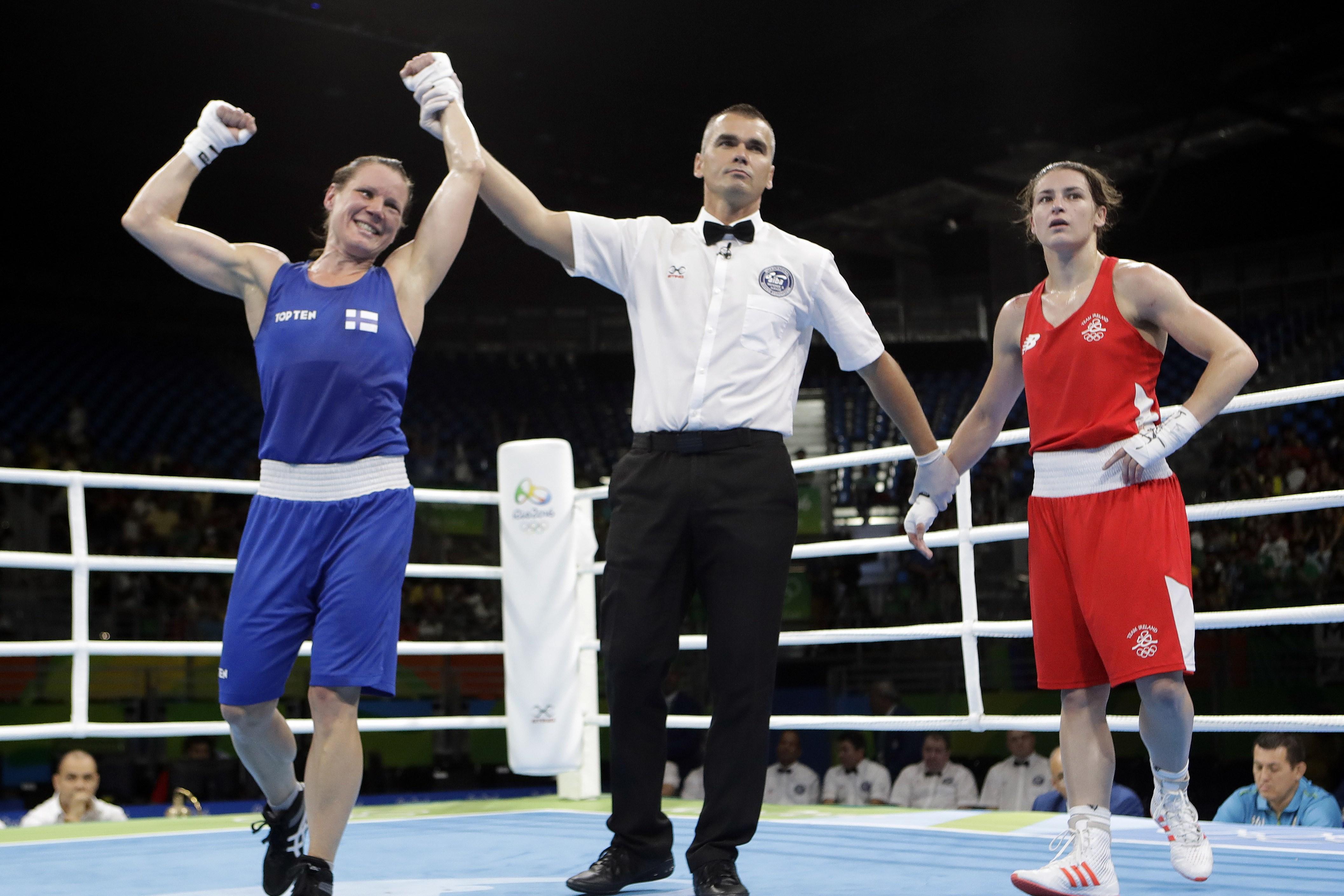 Finland's Mira Potkonen, left, reacts as she won a women's lightweight 60-kg quarterfinals boxing match against Ireland's Katie Taylor at the 2016 Summer Olympics in Rio de Janeiro, Brazil, Monday, Aug. 15, 2016. (AP Photo/Frank Franklin II)