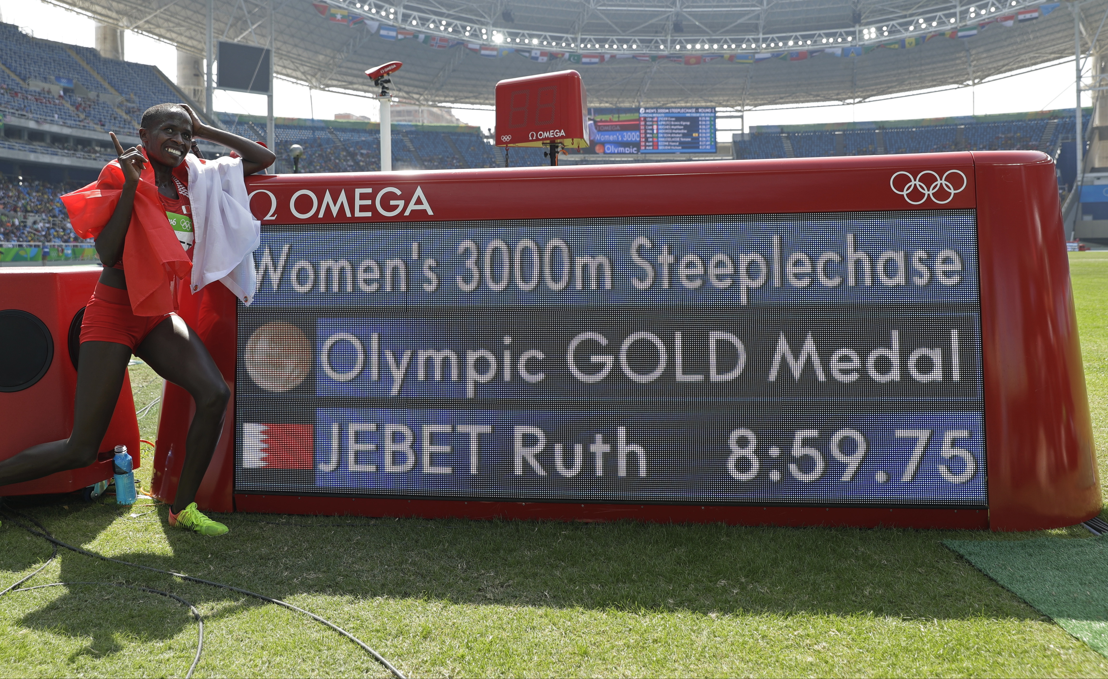 Bahrain's Ruth Jebet poses beside the timing board after winning the gold medal in the women's 3000-meter steeplechase final during the athletics competitions in the Olympic stadium of the 2016 Summer Olympics in Rio de Janeiro, Brazil, Monday, Aug. 15, 2
