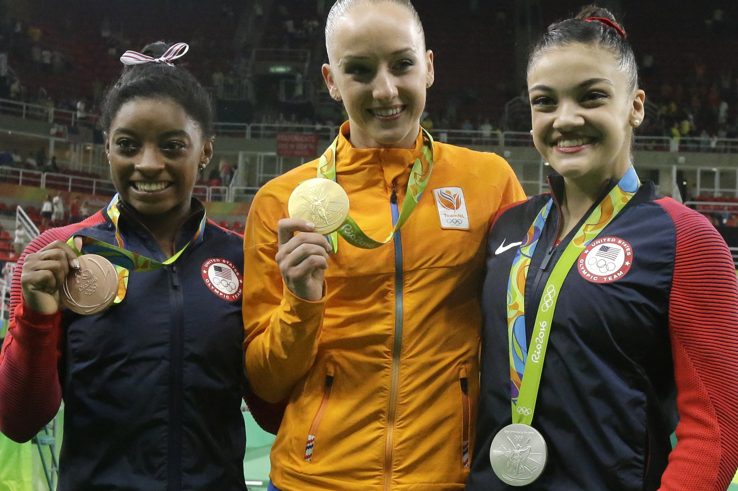 Netherlands' Sanne Wevers, center, gold, United States' Lauren Hernandez, right, silver, and United States' Simone Biles, bronze, display their medals for balance beam during the artistic gymnastics women's apparatus final at the 2016 Summer Olympics in R