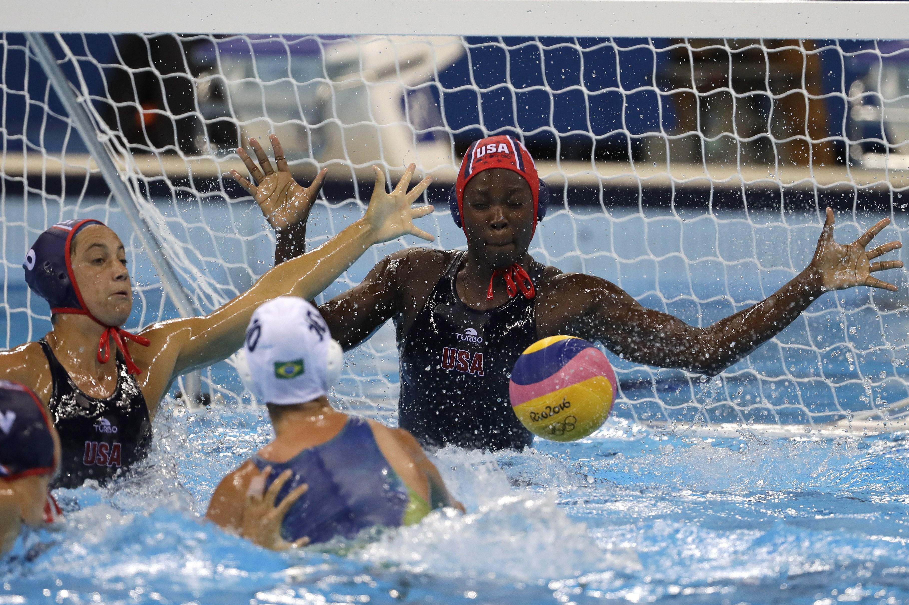 United States' Ashleigh Johnson makes a save during their women's water polo quarterfinal match against Brazil at the 2016 Summer Olympics in Rio de Janeiro, Brazil, Monday, Aug. 15, 2016. (AP Photo/Eduardo Verdugo)