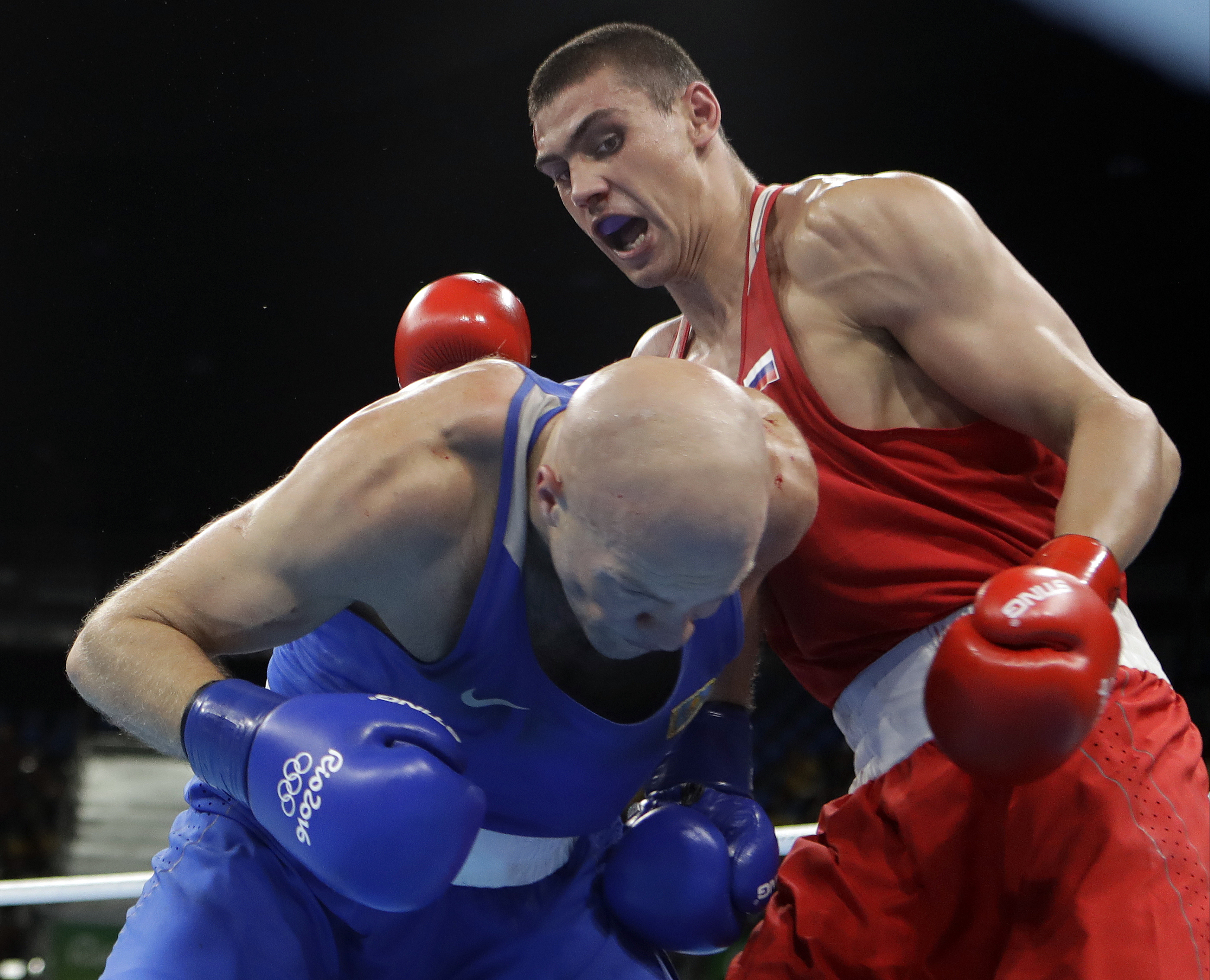 Russia's Evgeny Tishchenko, right, fights Kazakhstan's Vassiliy Levit during a men's heavyweight 91-kg final boxing match at the 2016 Summer Olympics in Rio de Janeiro, Brazil, Monday, Aug. 15, 2016. (AP Photo/Frank Franklin II)