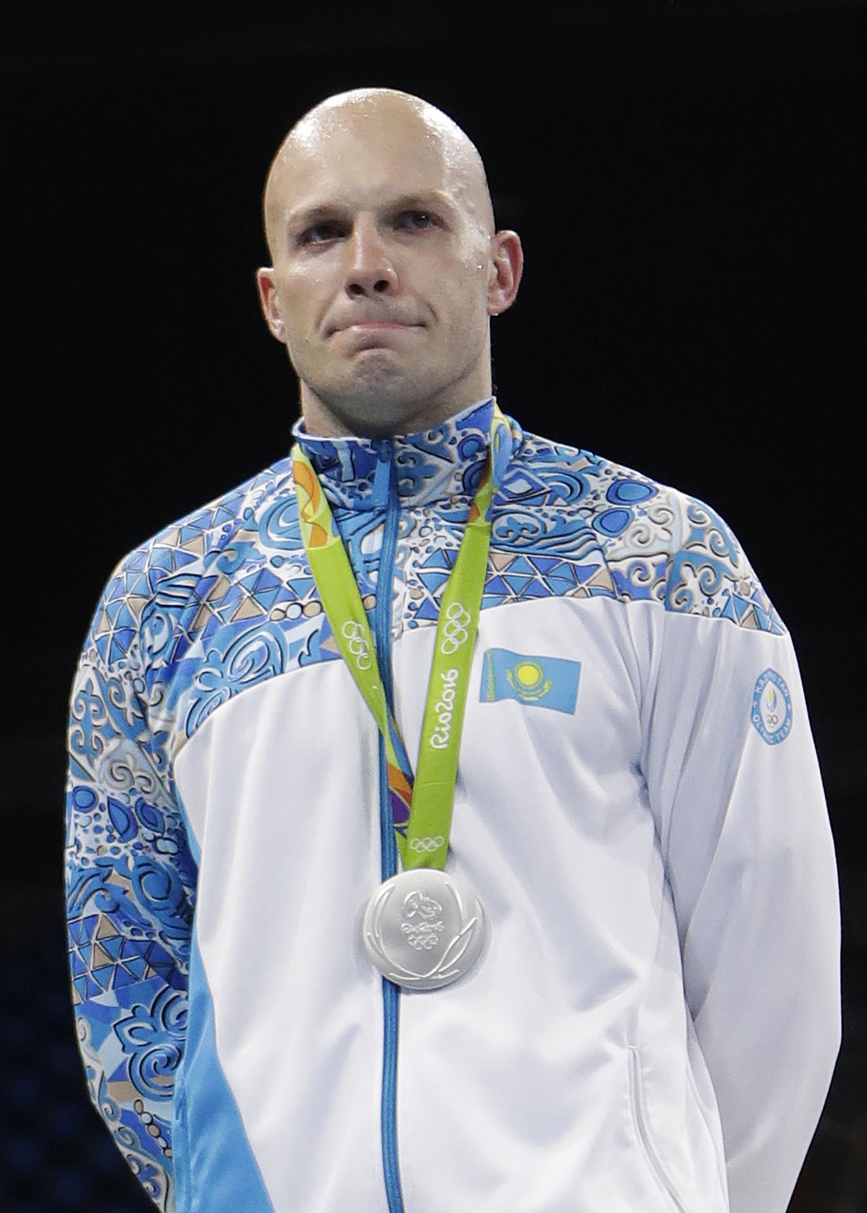 Kazakhstan's Vassiliy Levit displays his silver medal for the men's heavyweight 91-kg final boxing at the 2016 Summer Olympics in Rio de Janeiro, Brazil, Monday, Aug. 15, 2016. (AP Photo/Frank Franklin II)