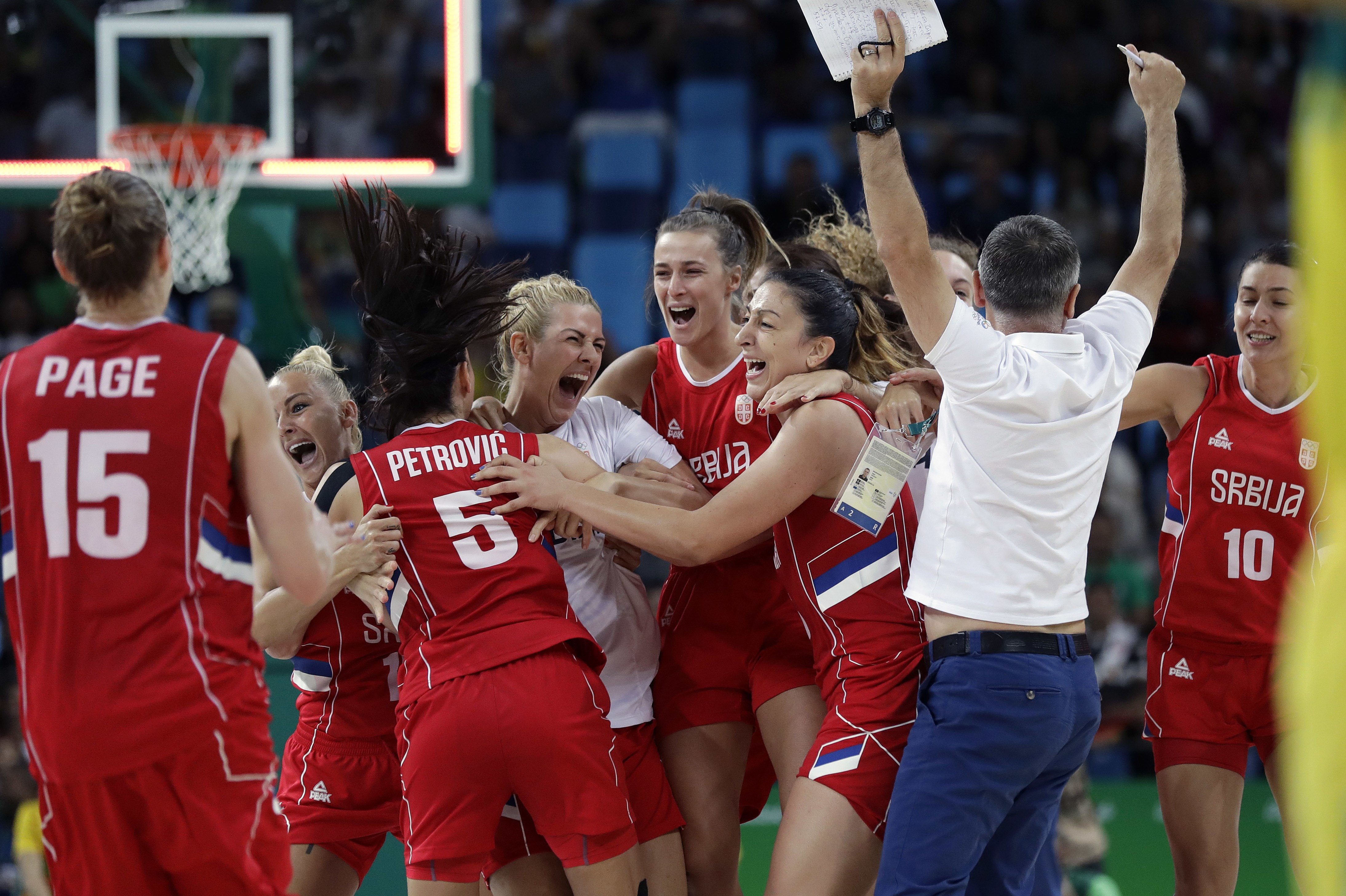 Team Serbia celebrates their win over Australia after a women's quarterfinal round basketball game at the 2016 Summer Olympics in Rio de Janeiro, Brazil, Tuesday, Aug. 16, 2016. (AP Photo/Eric Gay)