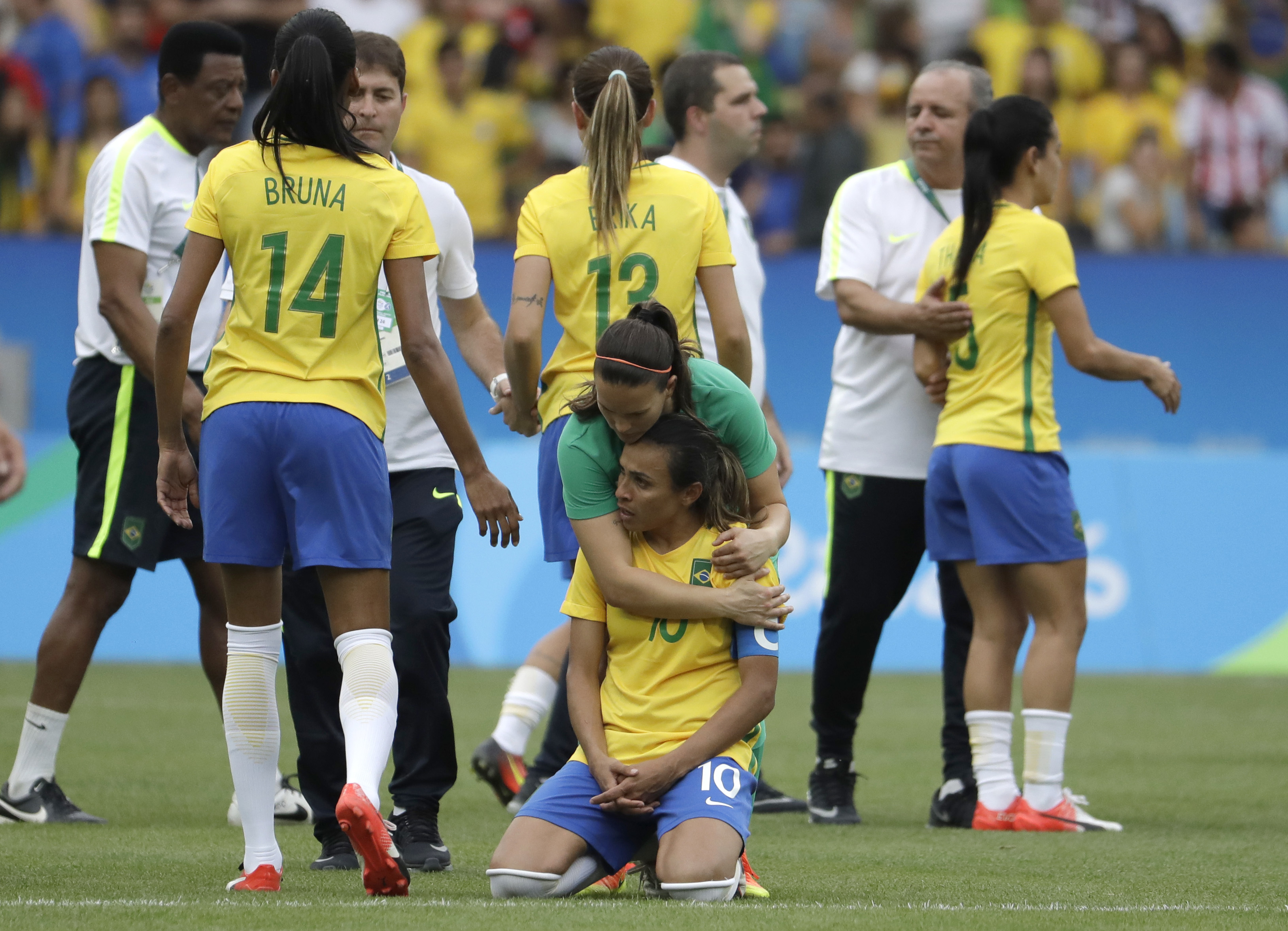 Brazil's Marta is comforted after the penalty kicks during a semi-final match of the women's Olympic football tournament between Brazil and Sweden at the Maracana stadium in Rio de Janeiro Tuesday Aug. 16, 2016. Sweden qualified for the final after beatin