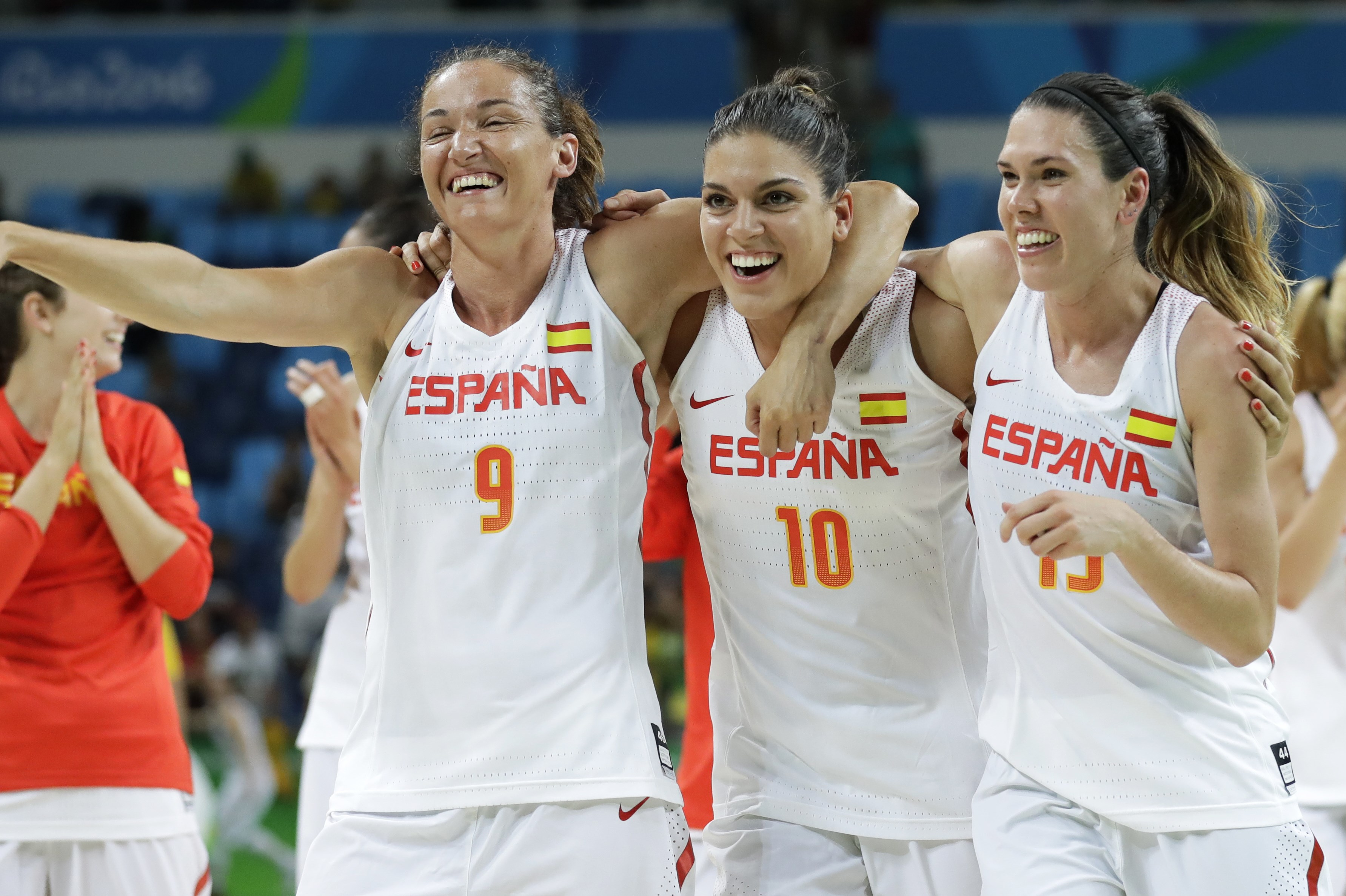 Spain's Laia Palau, from left, Marta Xargay and Anna Cruz celebrate after a quarterfinal round basketball game against Turkey at the 2016 Summer Olympics in Rio de Janeiro, Brazil, Tuesday, Aug. 16, 2016. (AP Photo/Charlie Neibergall)