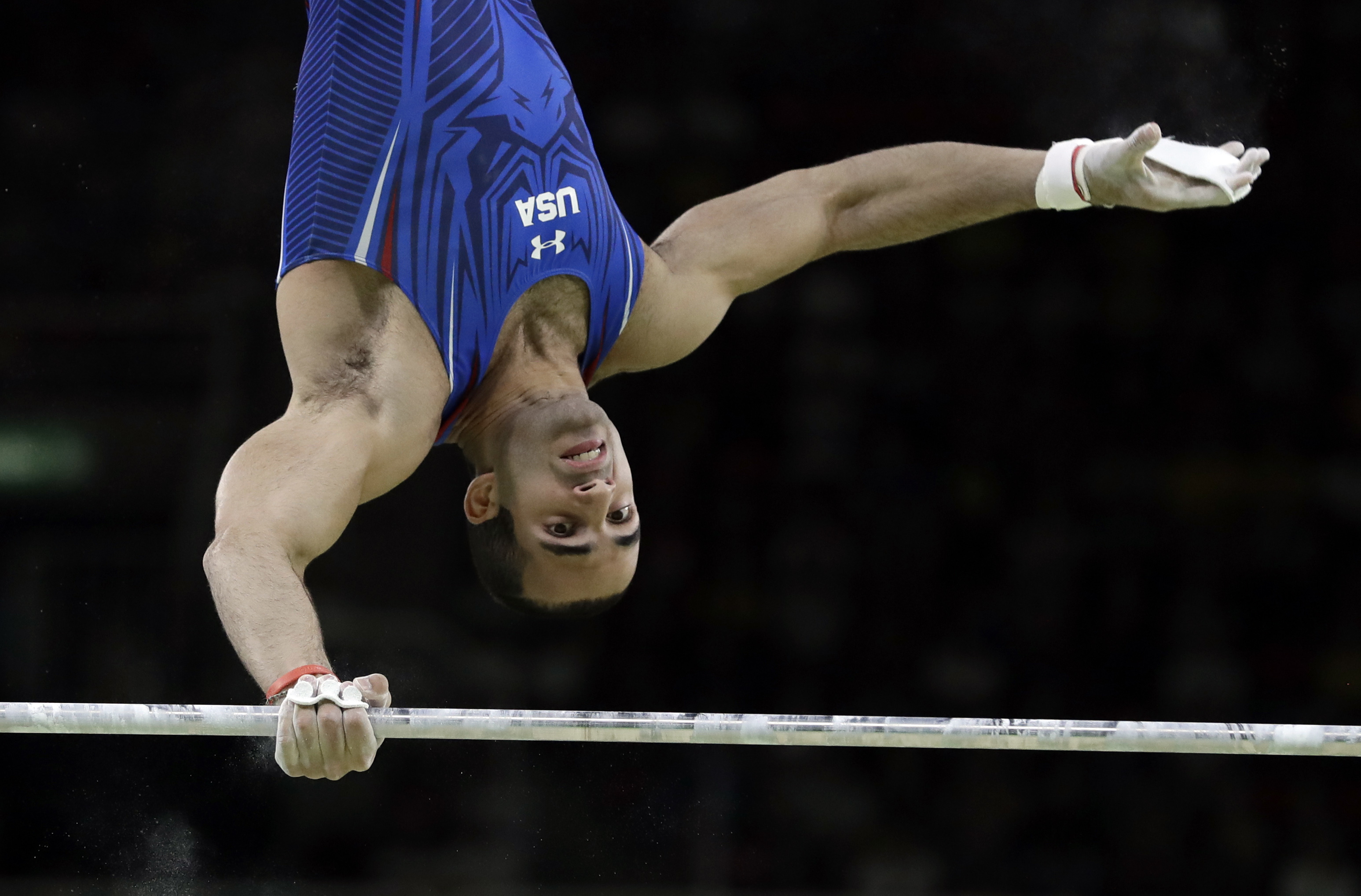 United States' Danell Leyva performs on the horizontal bar during the artistic gymnastics men's apparatus final at the 2016 Summer Olympics in Rio de Janeiro, Brazil, Tuesday, Aug. 16, 2016. (AP Photo/Rebecca Blackwell)