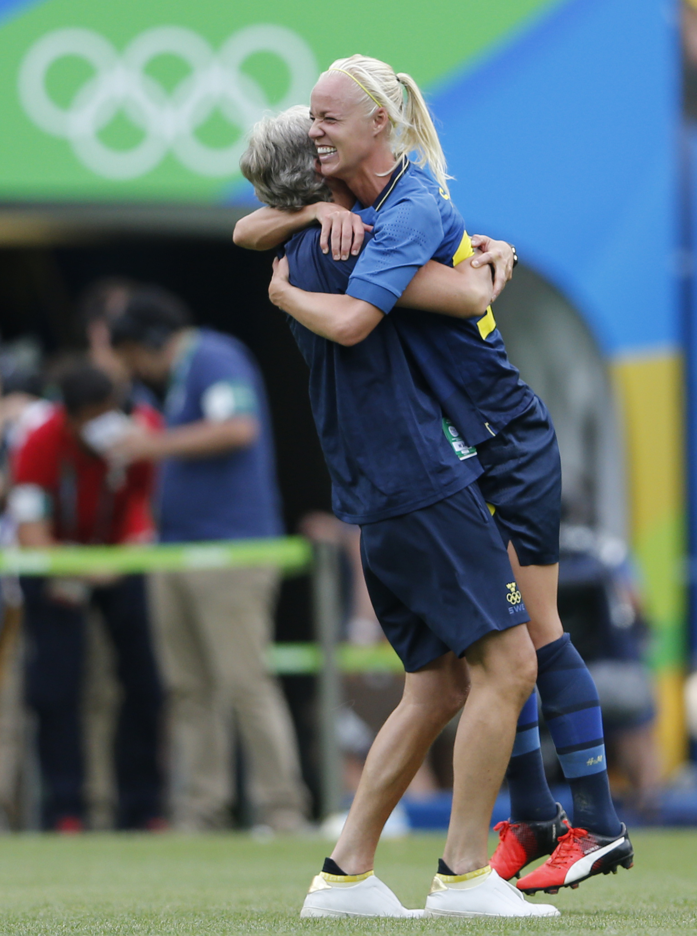 A Sweden player celebrate with a member of her team after penalty shootout during a semi-final match of the women's Olympic football tournament between Brazil and Sweden at the Maracana stadium in Rio de Janeiro, Brazil, Tuesday Aug. 16, 2016. Sweden qual