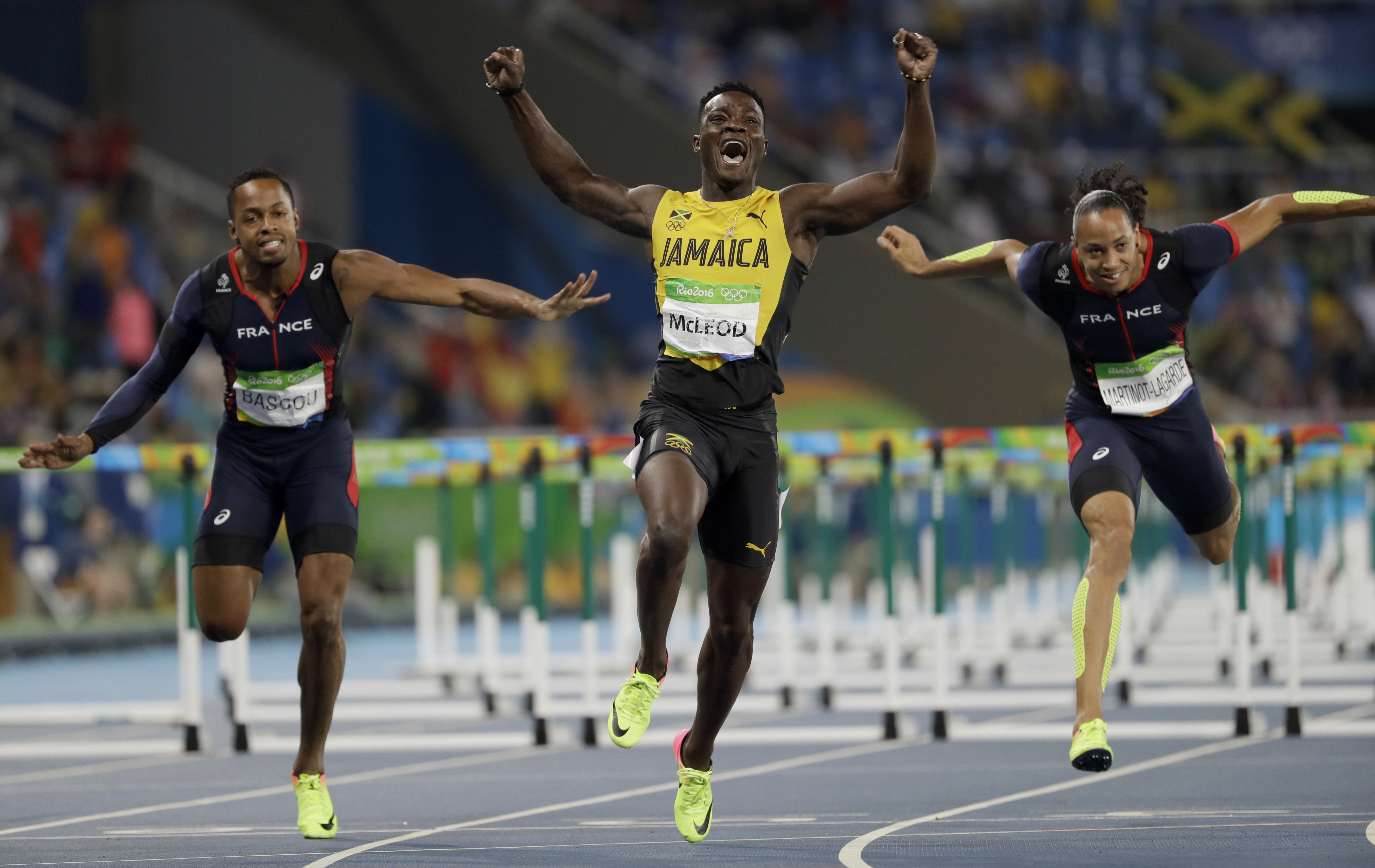 Jamaica's Omar Mcleod, center, wins the men's 110-meter hurdles final ahead of third placed France's Dimitri Bascou, left, and fourth placed France's Pascal Martinot-Lagarde during the athletics competitions of the 2016 Summer Olympics at the Olympic stad