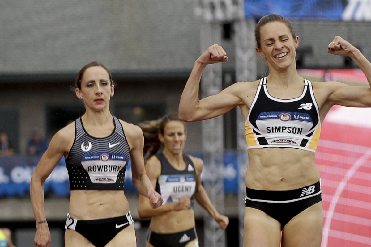 Jenny Simpson, right, celebrates as she wins in the finals of the women's 1500-meter run at the U.S. Olympic Track and Field Trials, Sunday, July 10, 2016, in Eugene Ore. (AP Photo/Marcio Jose Sanchez)