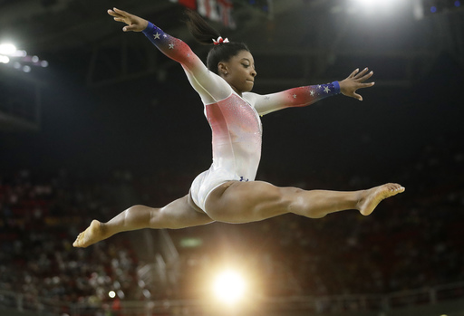 United States' Simone Biles performs on the balance beam during the gymnastics exhibition gala at the 2016 Summer Olympics in Rio de Janeiro, Brazil, Wednesday, Aug. 17, 2016. (AP Photo/Dmitri Lovetsky)