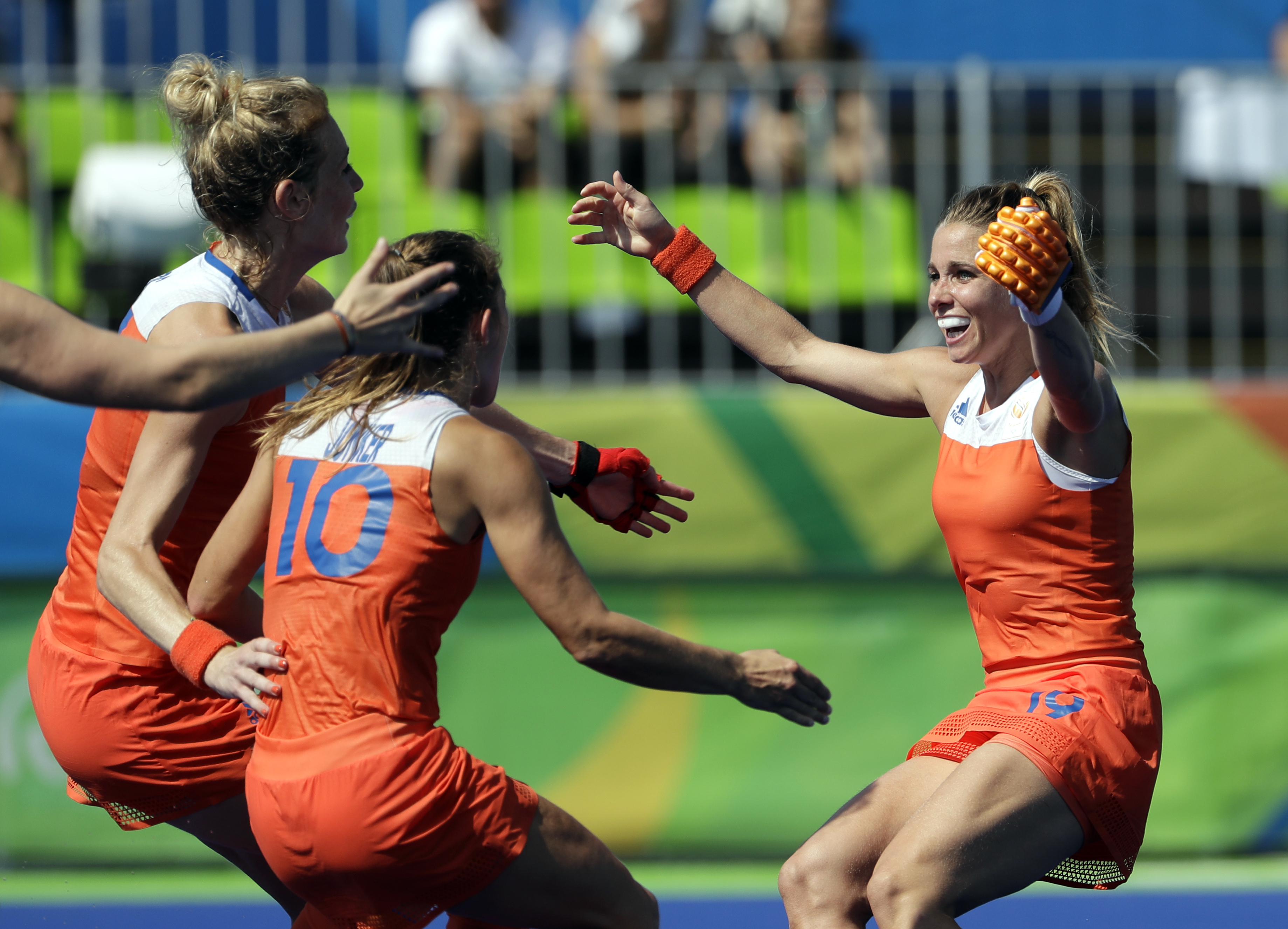 Netherlands' Ellen Hoog, right, celebrates with teammates her last shootout penalty goal which give the wining to her team against Germany, during a women's field hockey semifinal match at 2016 Summer Olympics in Rio de Janeiro, Brazil, Wednesday, Aug. 17