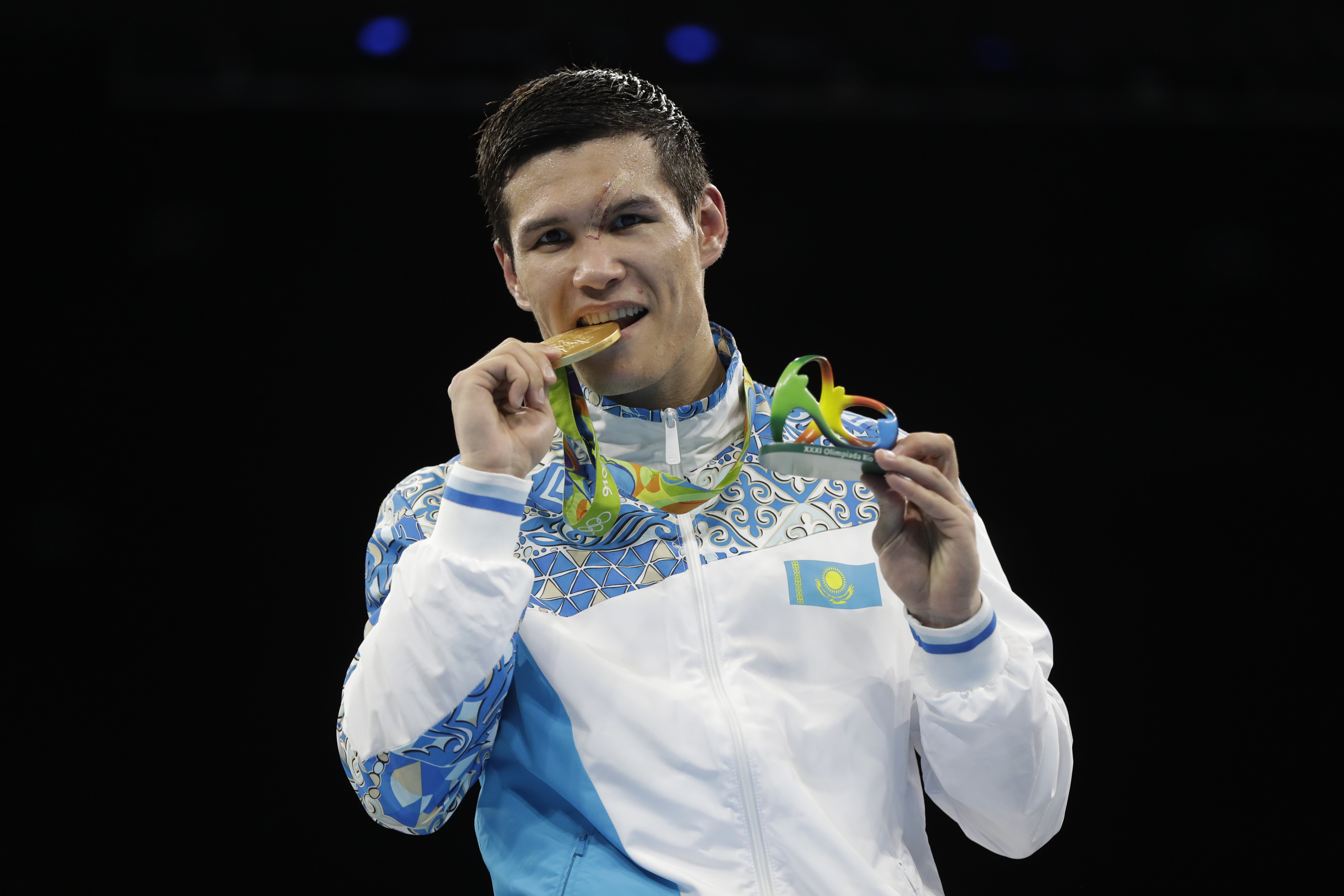 Kazakhstan's Daniyar Yeleussinov displays his gold medal for the men's welterweight 69-kg final boxing at the 2016 Summer Olympics in Rio de Janeiro, Brazil, Wednesday, Aug. 17, 2016. (AP Photo/Frank Franklin II)
