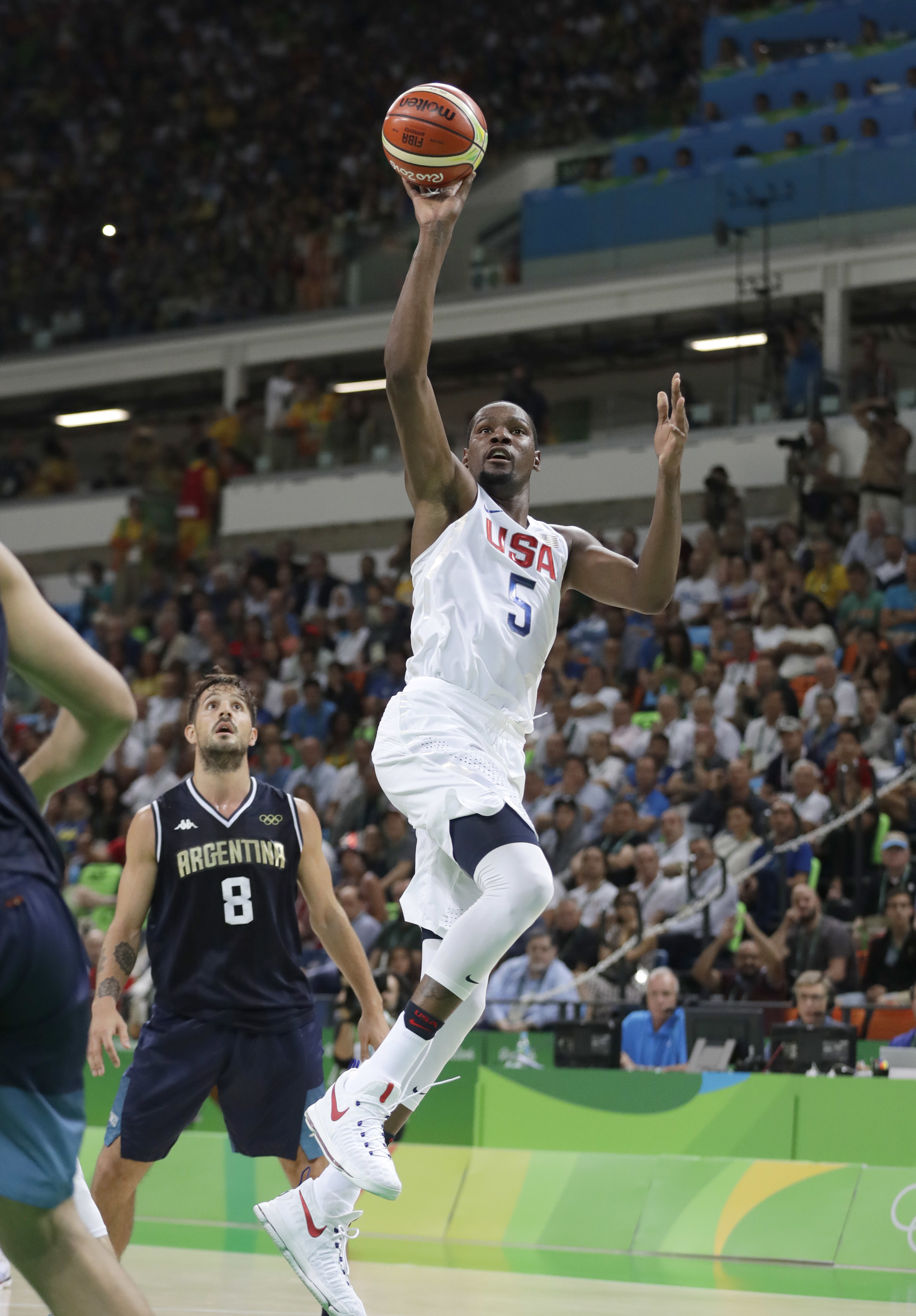 United States' Kevin Durant (5) shoots pat Argentina's Nicolas Laprovittola (8) during a men's quarterfinal round basketball game at the 2016 Summer Olympics in Rio de Janeiro, Brazil, Wednesday, Aug. 17, 2016. (AP Photo/Eric Gay)