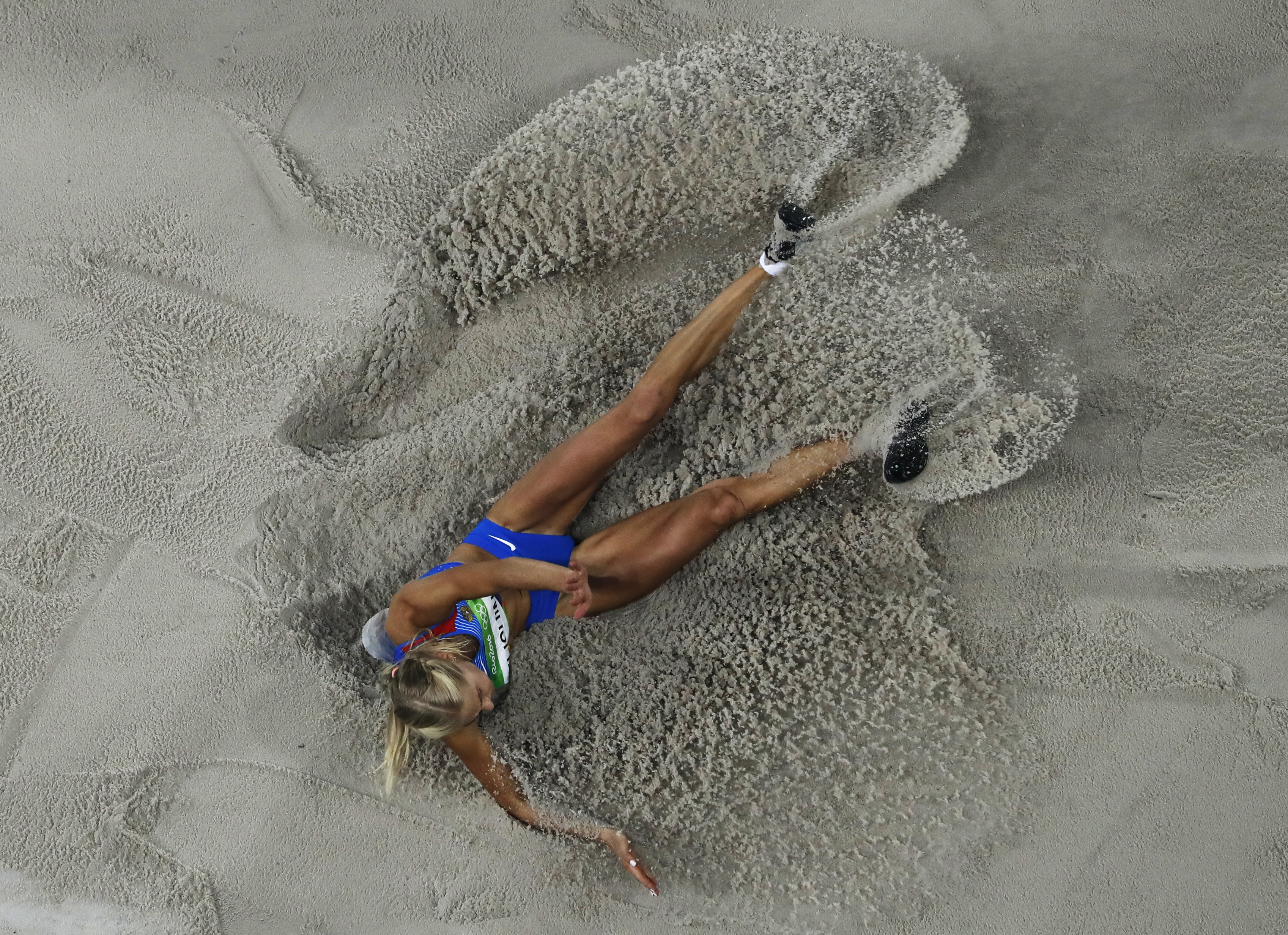 Russia's Darya Klishina competes in the long jump finals during the athletics competitions of the 2016 Summer Olympics at the Olympic stadium in Rio de Janeiro, Brazil, Wednesday, Aug. 17, 2016. (AP Photo/Morry Gash)