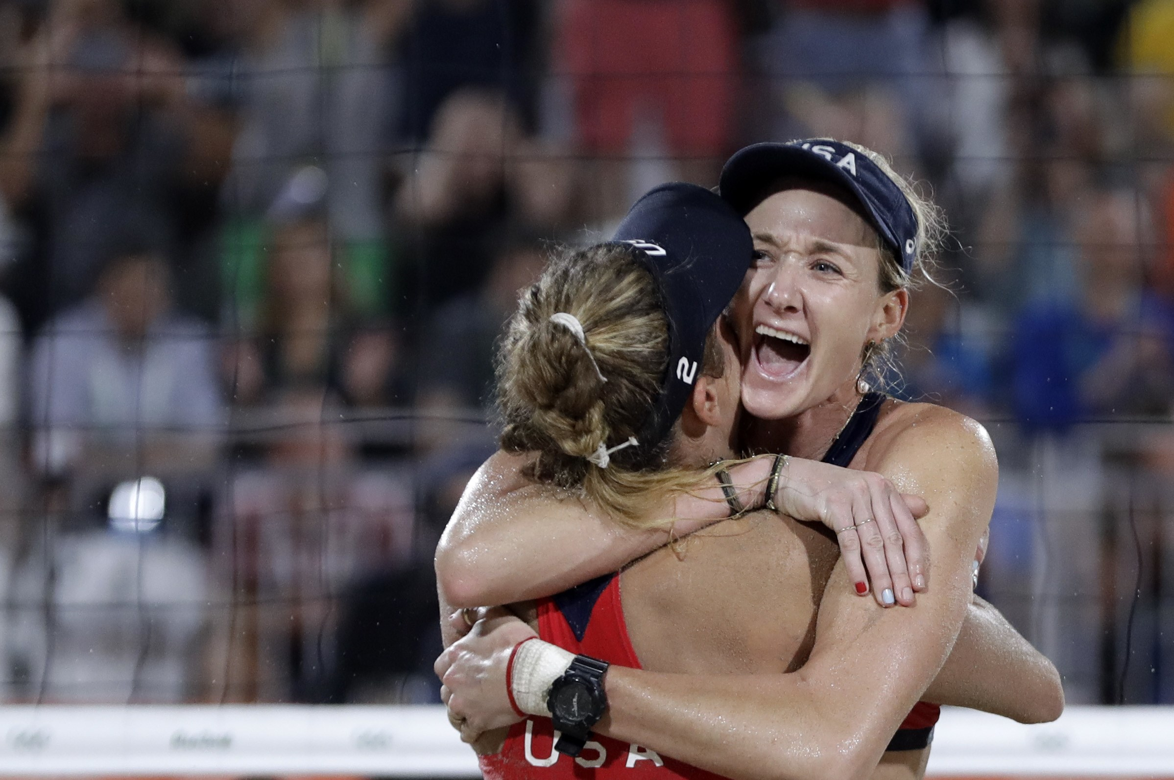 United States' Kerri Walsh Jennings, right, celebrates with teammate April Ross after defeating Brazil during the women's beach volleyball bronze medal match of the 2016 Summer Olympics in Rio de Janeiro, Brazil, Wednesday, Aug. 17, 2016. (AP Photo/Petr D