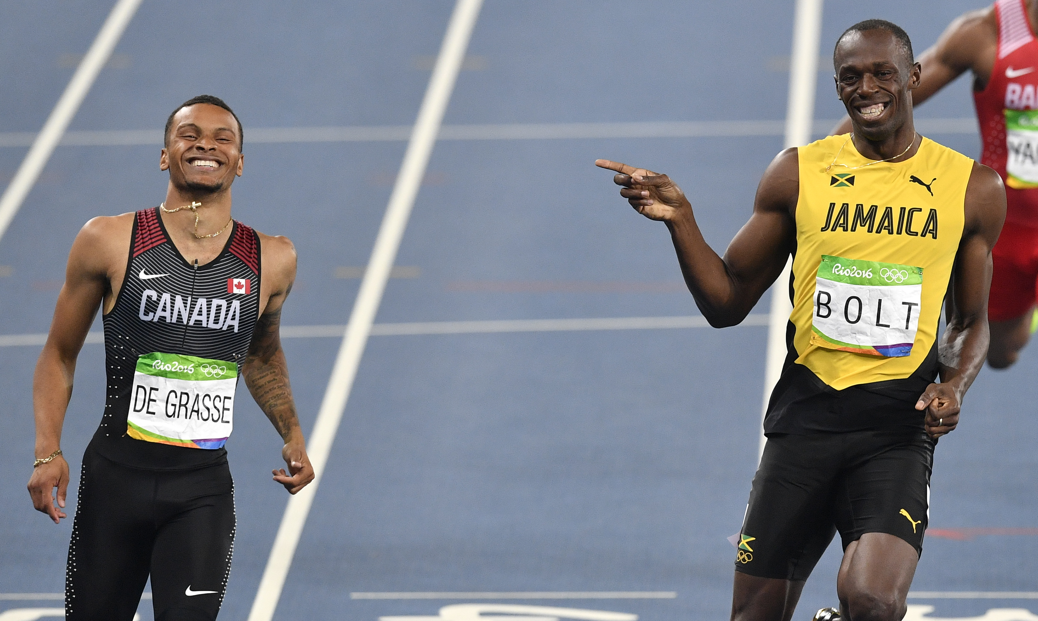 Jamaica's Usain Bolt and Canada's Andre De Grasse, left, compete in a men's 200-meter semifinal during the athletics competitions of the 2016 Summer Olympics at the Olympic stadium in Rio de Janeiro, Brazil, Wednesday, Aug. 17, 2016. (AP Photo/Martin Meis